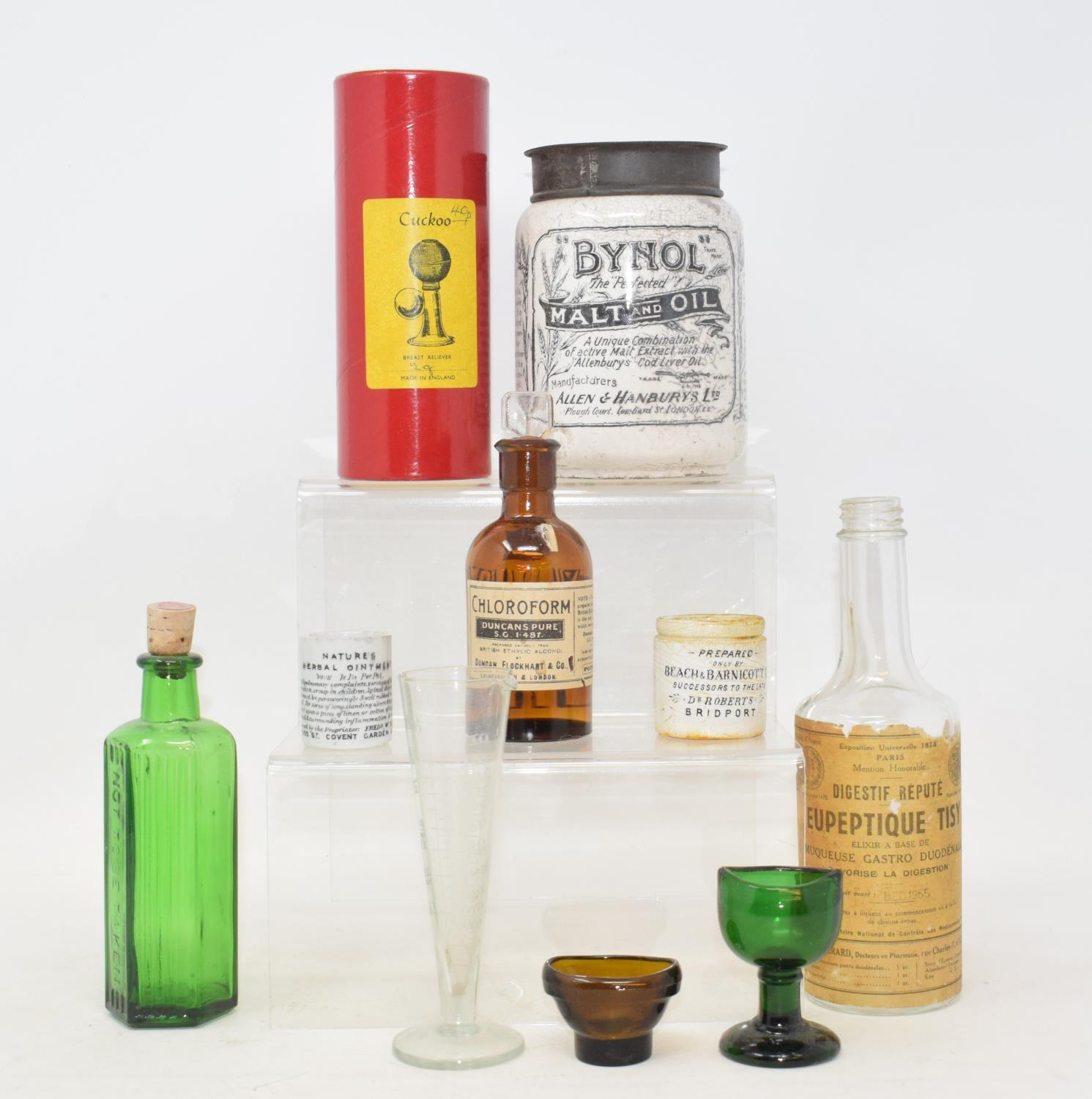 Lot 3 - A collection of medical apothecary items, including bottles, measures, jars, syringes and a Cuckoo