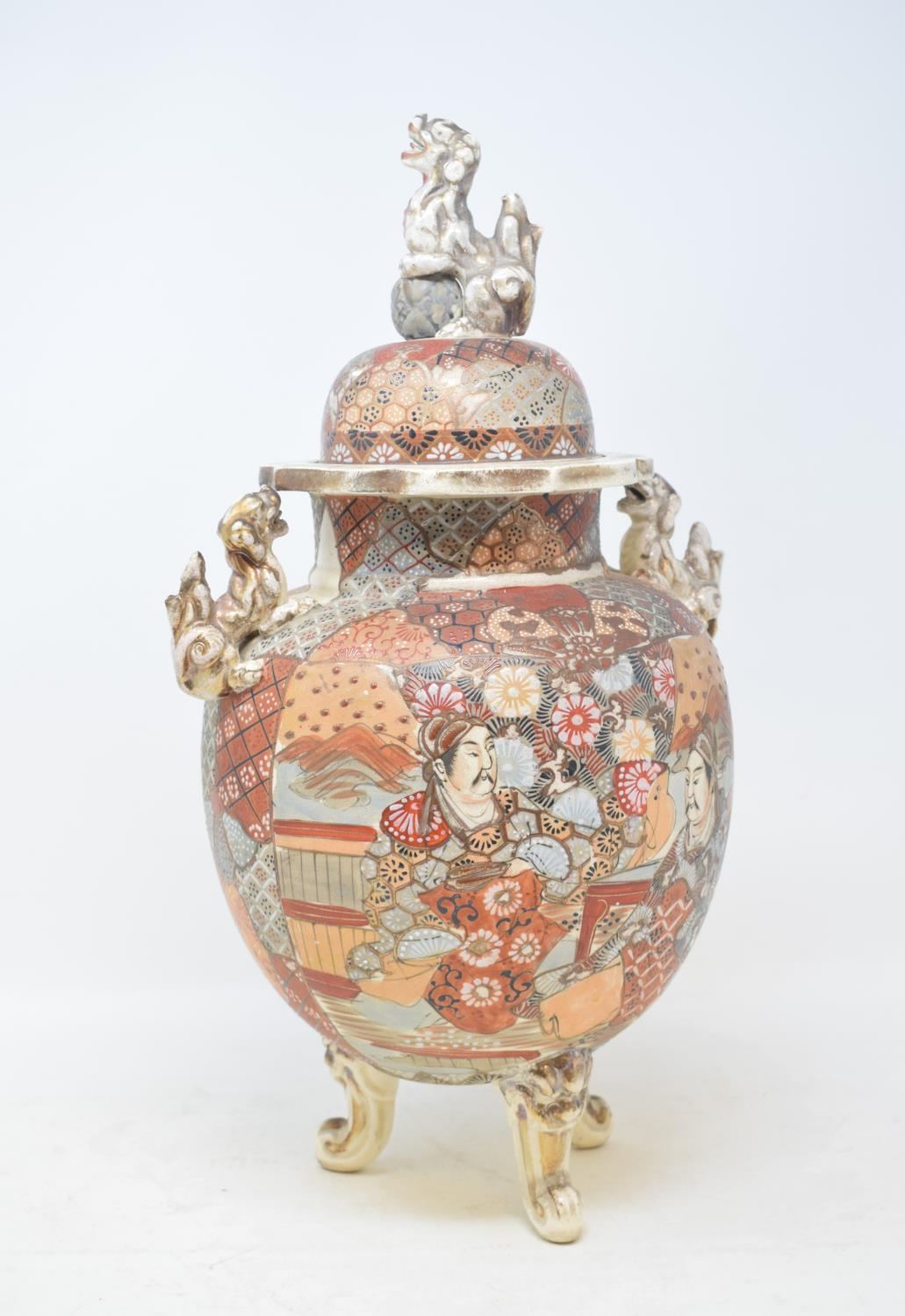A Japanese Satsuma vase and cover, decorated figures, with a Dog of Fo finial, 40 cm high, and three