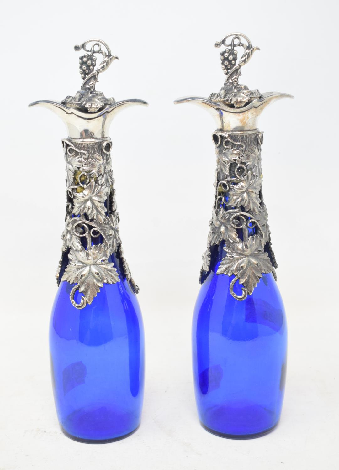 A pair of blue glass decanters, with plated mounts, 16.5 cm high (2) Modern