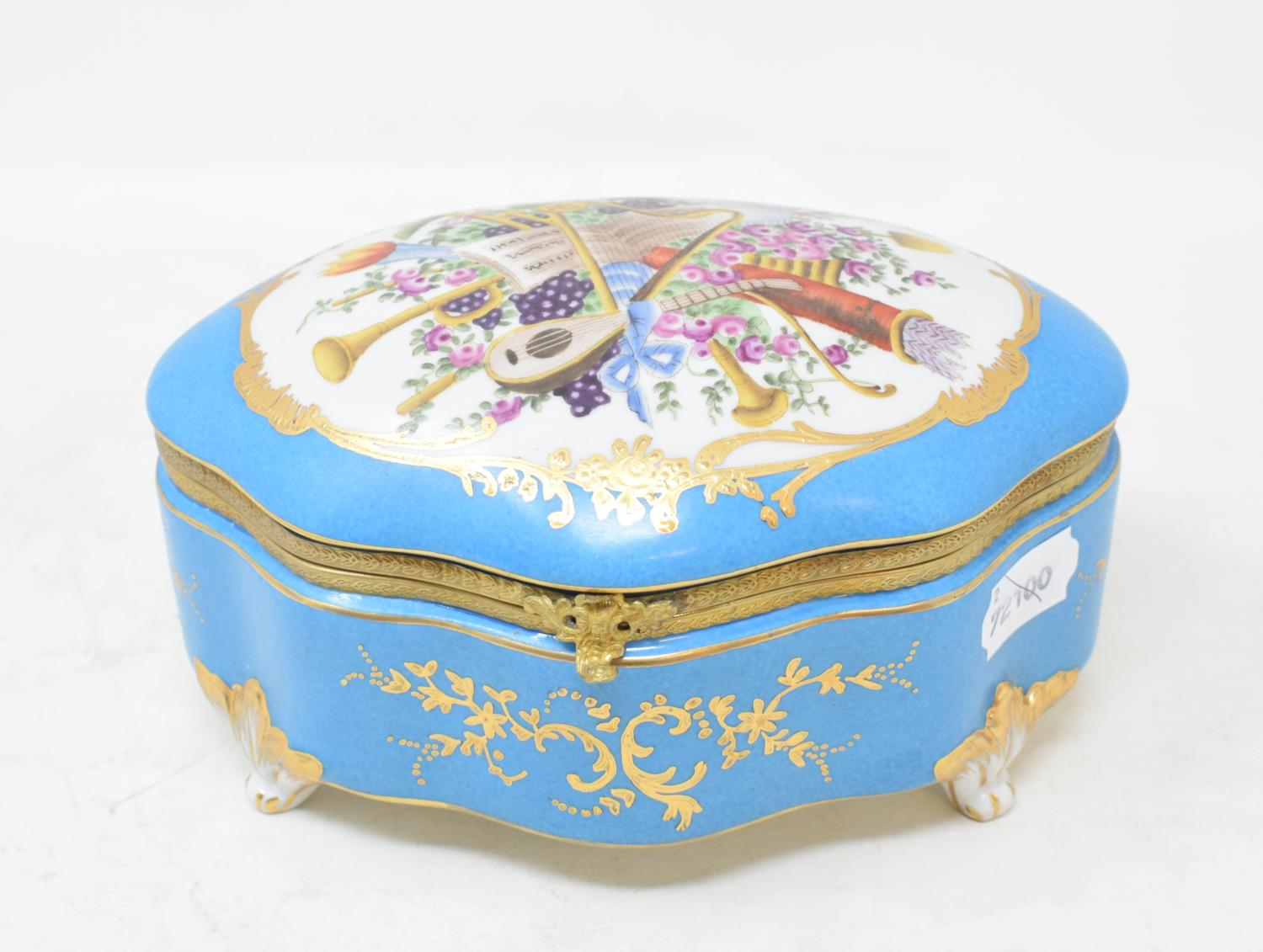 Lot 15 - A Sevres style porcelain box, decorated musical instruments, 20 cm wide Modern
