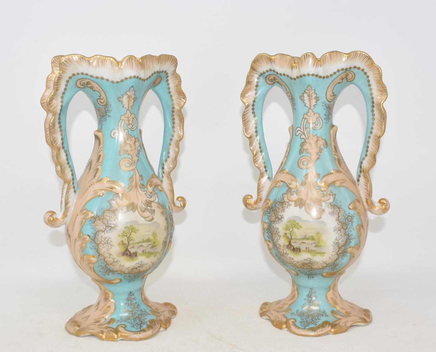 Lot 10 - A pair of two handled porcelain vases, each decorated a landscape, 25 cm high (2) Modern