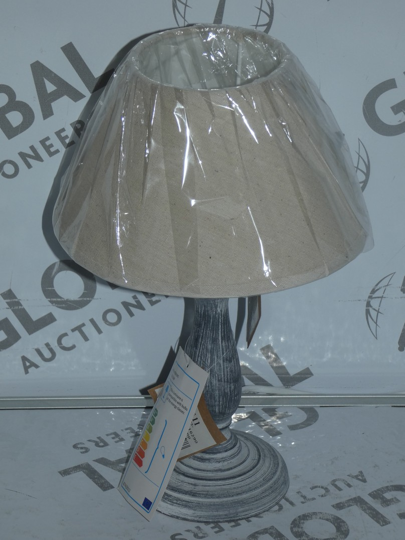 Lot 106 - Lot to Contain 6 Assorted Grey Stone Effect and Copper Table Lamps Combined RRP £180 (10568)(
