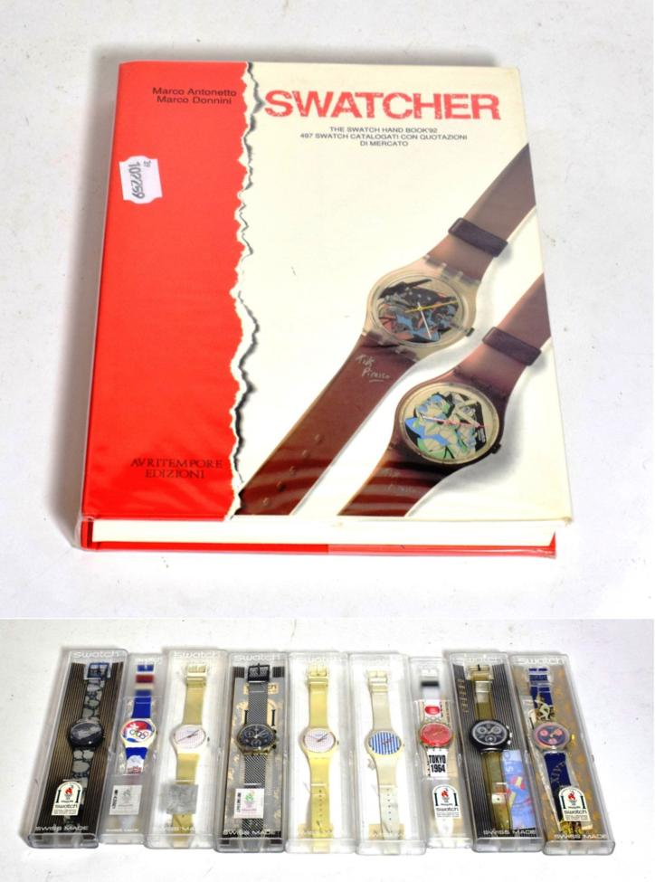Lot 258 - Nine Swatch watches in plastic cases, all with new batteries and a Swatcher Collectables book