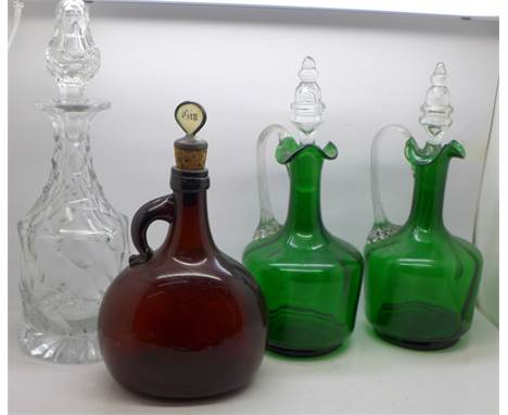 A pair of 19th Century green glass decanters, an amber glass Gin decanter and a 19th Century crystal decanter
