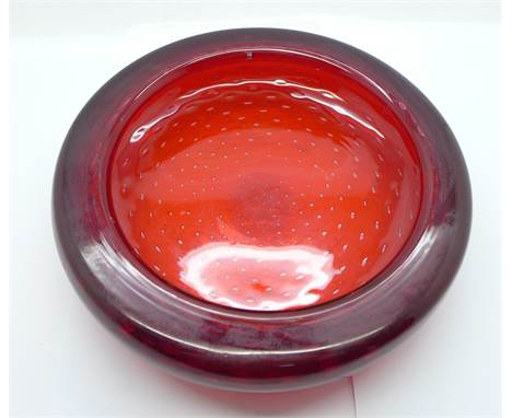 A Whitefriars ruby glass dish with controlled bubble decoration