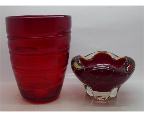 A Whitefriars ruby red glass controlled bubble bowl and a red glass vase