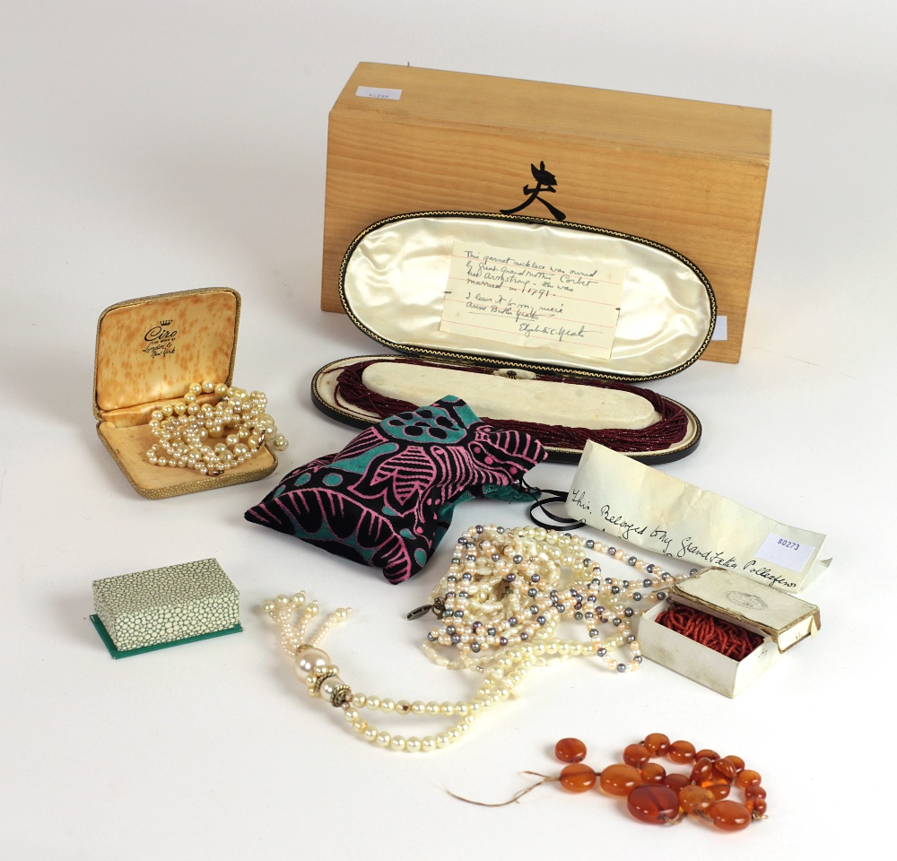 Lot 58 - Jewellery: A box of varied antique pearl Necklaces, some coral ditto, a very good garnet Necklace,