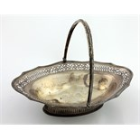 A large and very attractive English silver Fruit Basket, with pierced and engraved shaped rim,