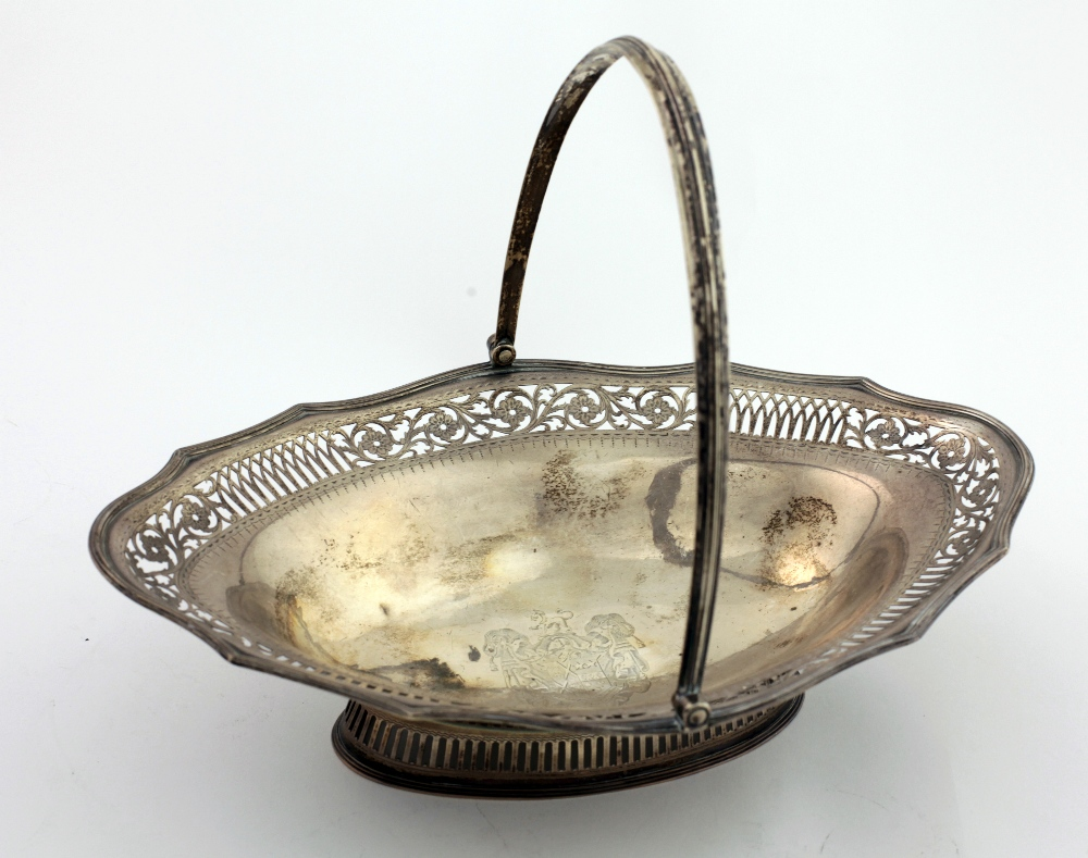 Lot 49 - A large and very attractive English silver Fruit Basket, with pierced and engraved shaped rim,
