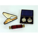 A cased pair Barometer & Compass; a crimson cutglass double ended Scent Bottle;