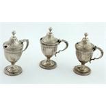 Lot 43 - A set of three Georgian period urn shaped Mustard or Condiment Pots,