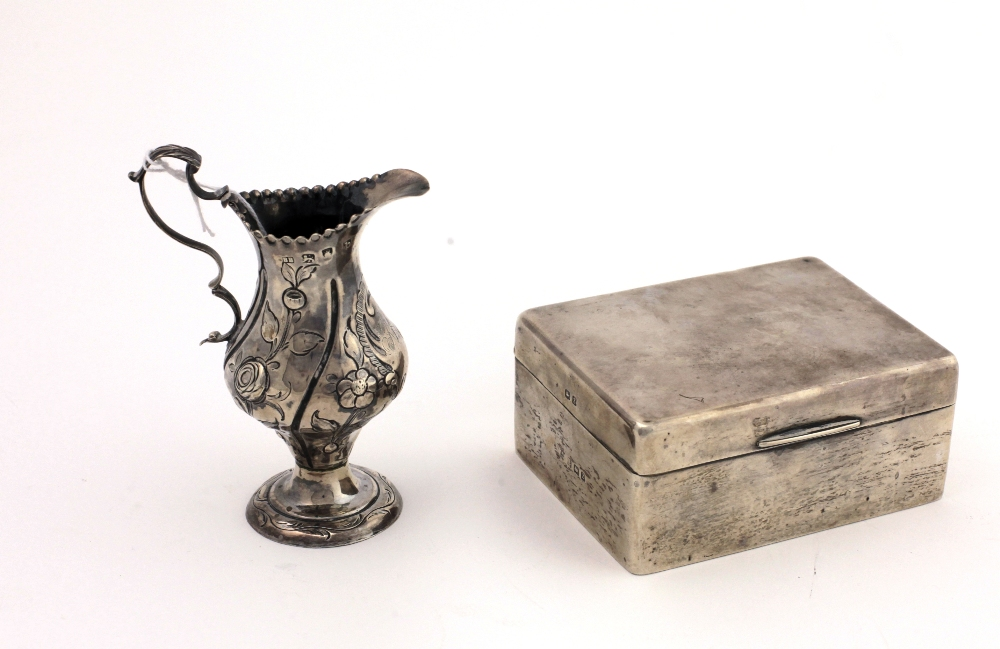 Lot 31 - A small embossed George III silver Cream Jug, London c.