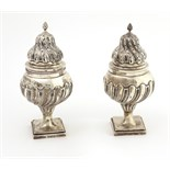 A very unusual and important pair of large early George III English silver Sugar Castors, London c.