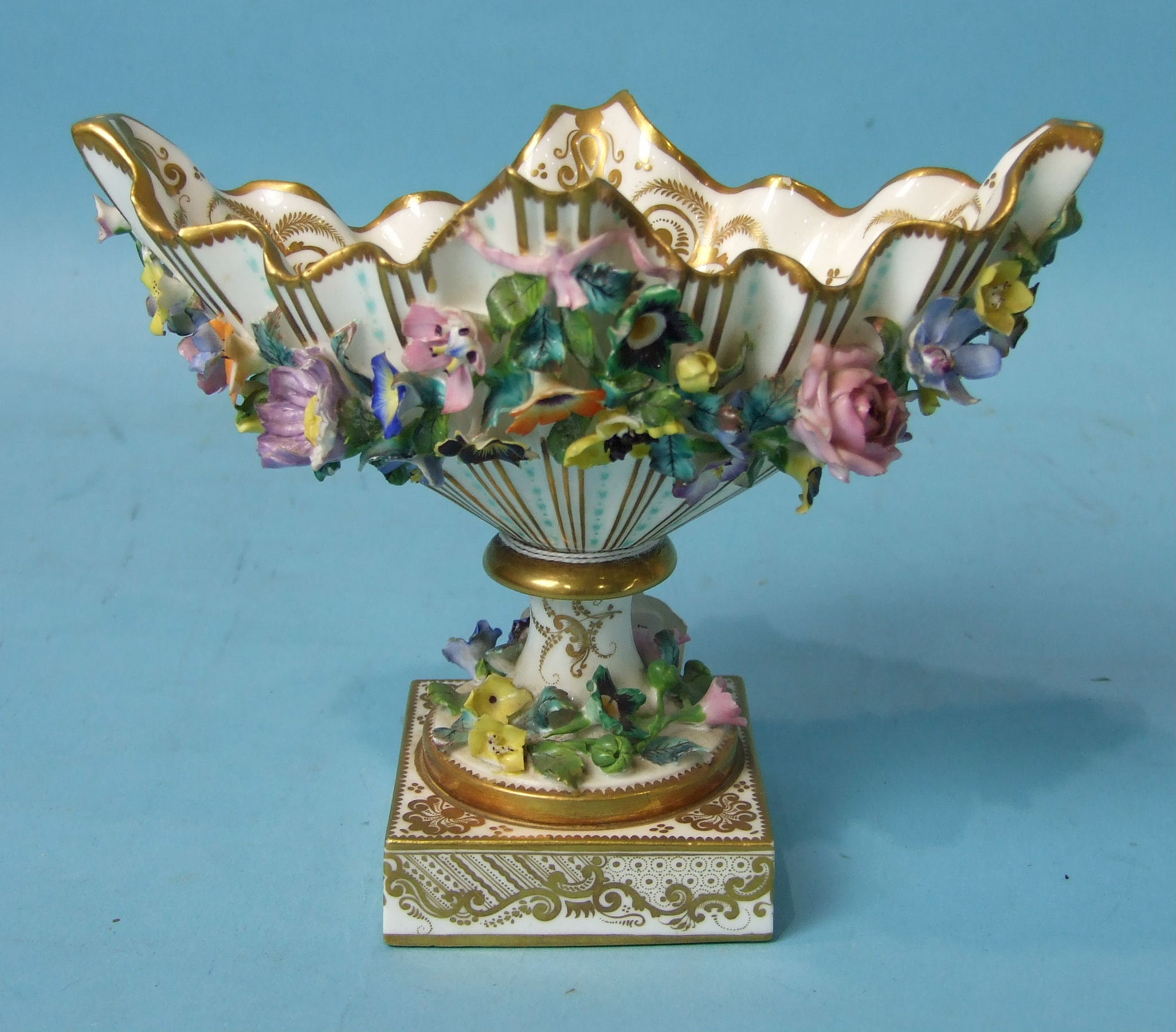 Lot 393 - A mid-19th century Minton porcelain boat-shaped vase on square base encrusted with flowers, fine