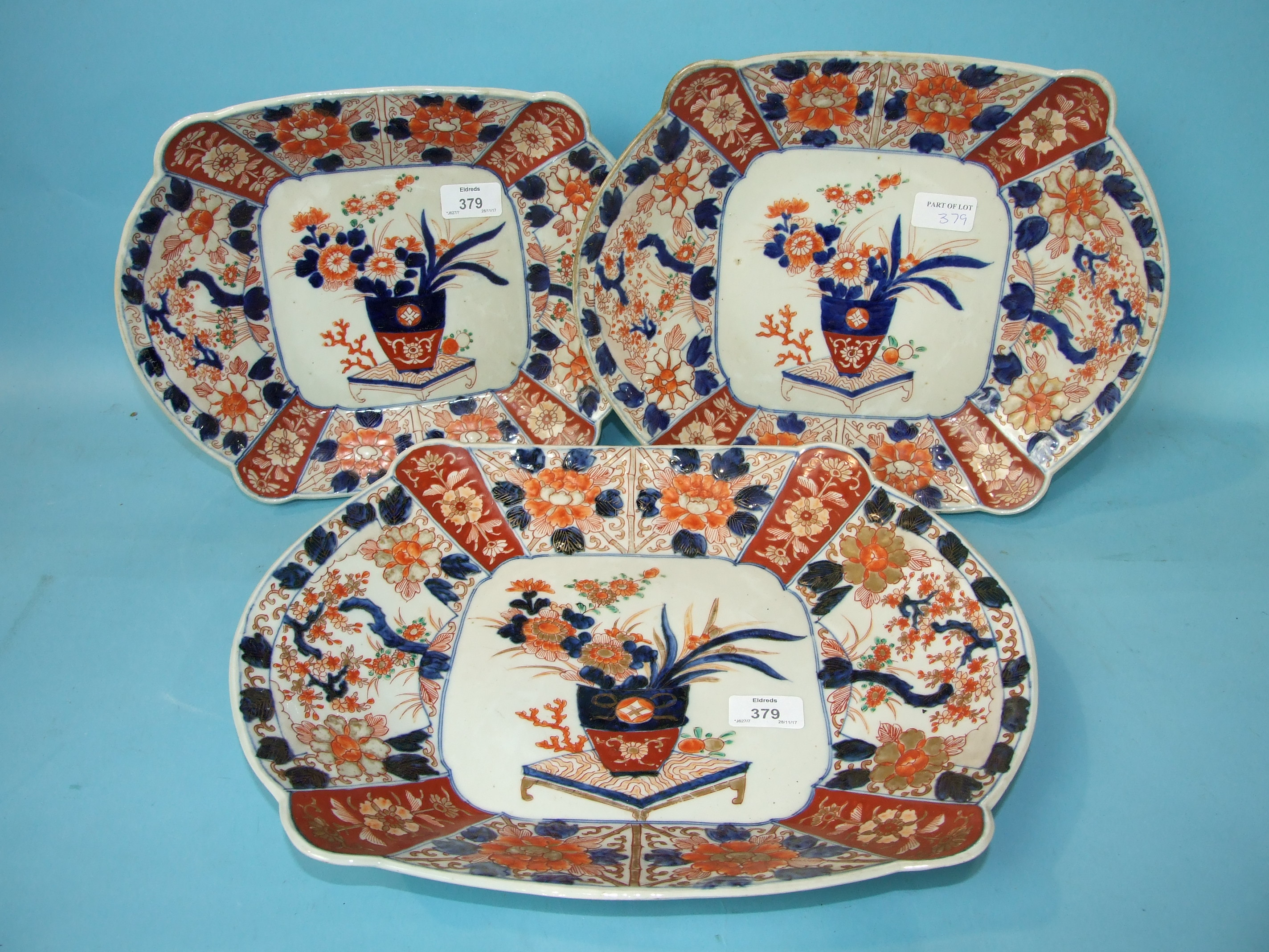 Lot 379 - A graduated set of three Japanese Imari shaped oval dishes, largest 40cm long.