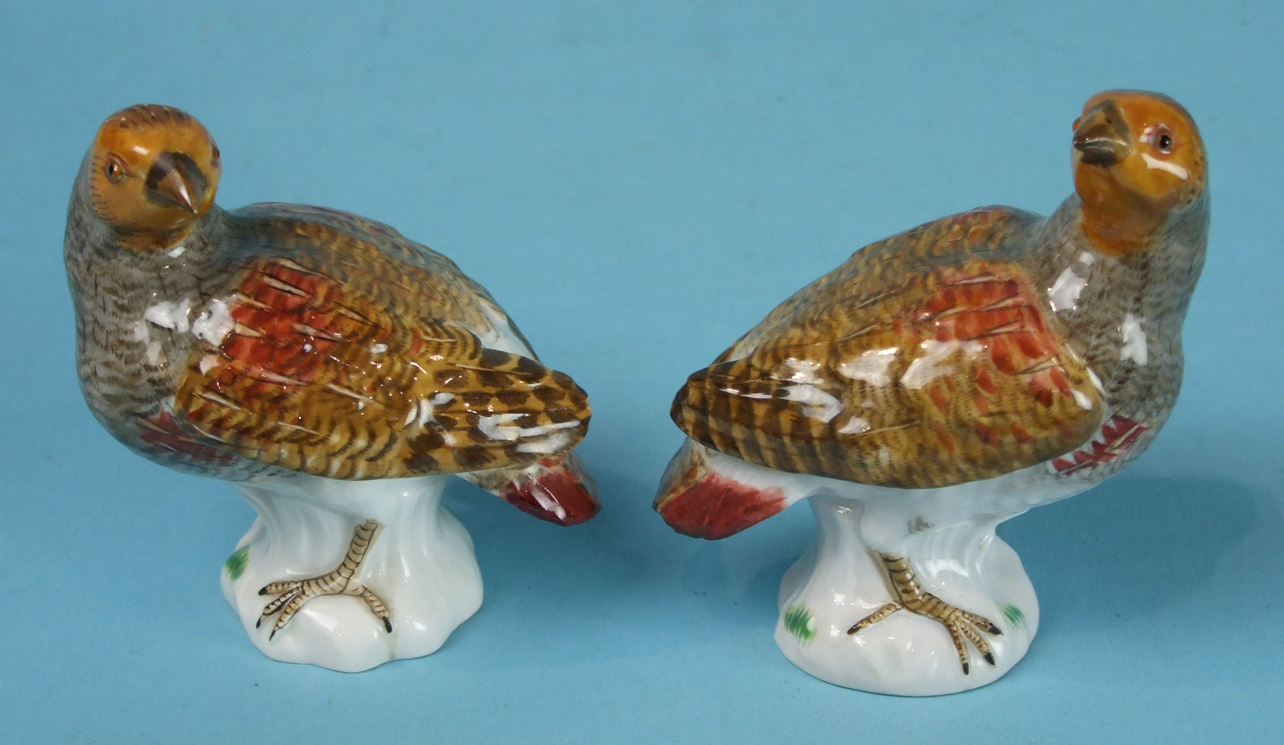Lot 411 - A pair of small Meissen porcelain models of English Partridges, crossed swords mark, 20th century,
