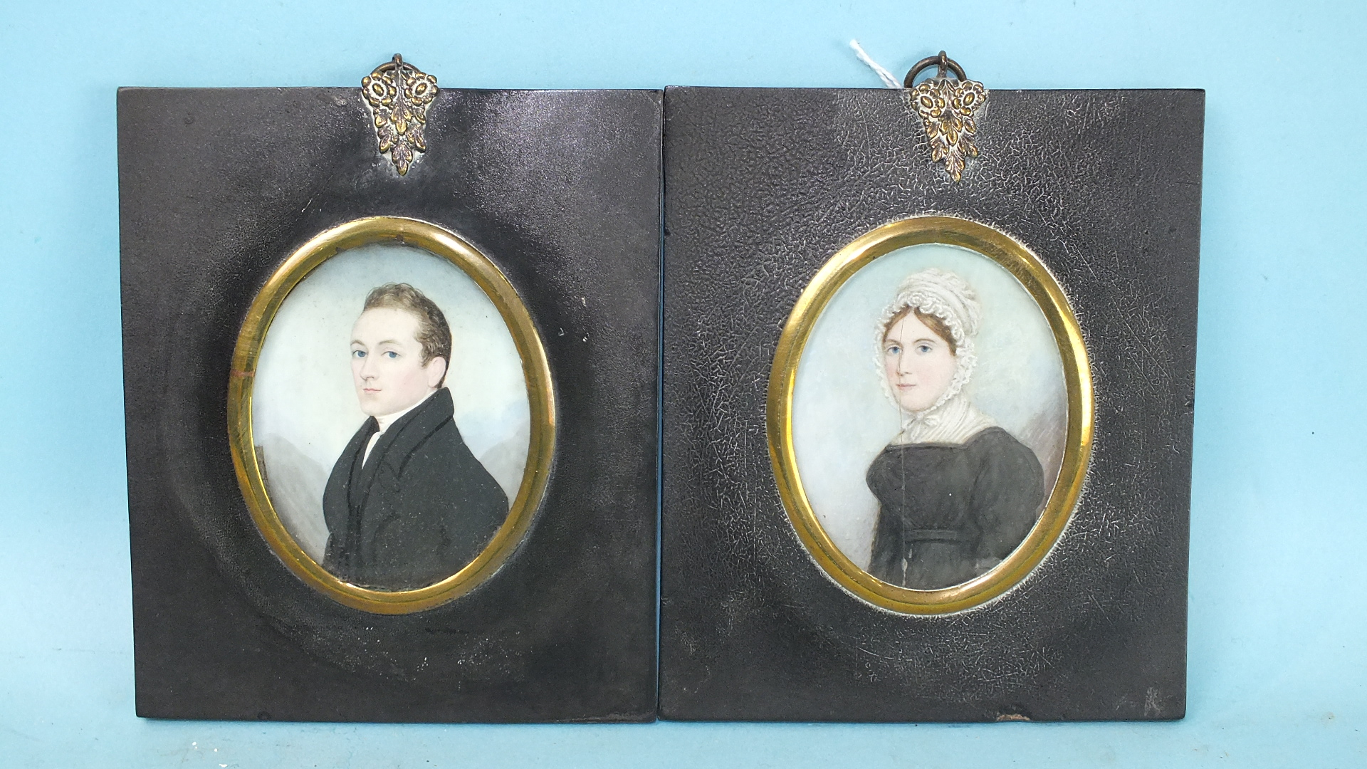 Lot 56 - 19th century, an oval miniature portrait of a young lady wearing a white lace-trimmed dress,