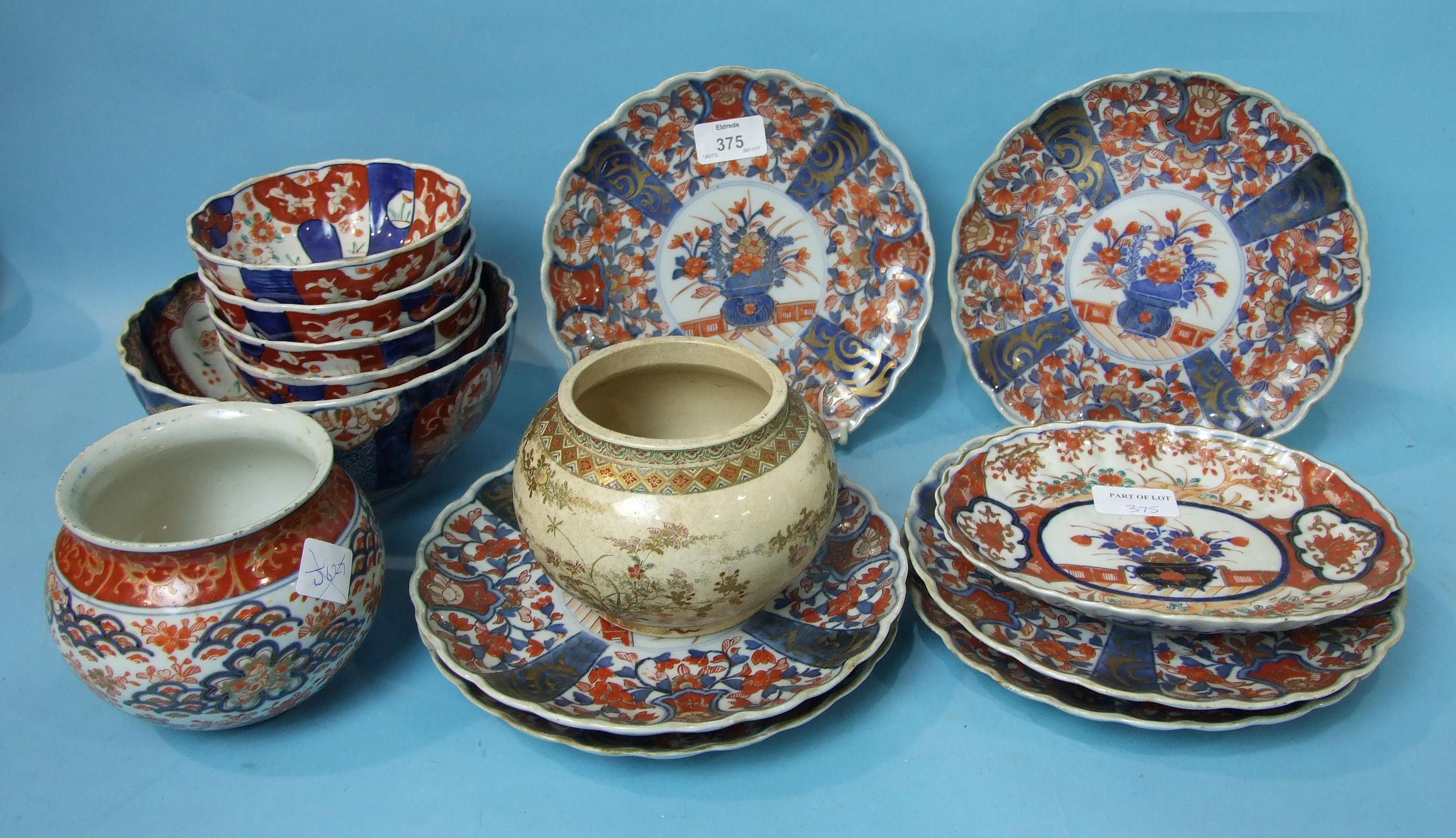 Lot 375 - A set of six Japanese Imari shaped-rim plates, 21cm diameter, a similar oval dish, six similar bowls
