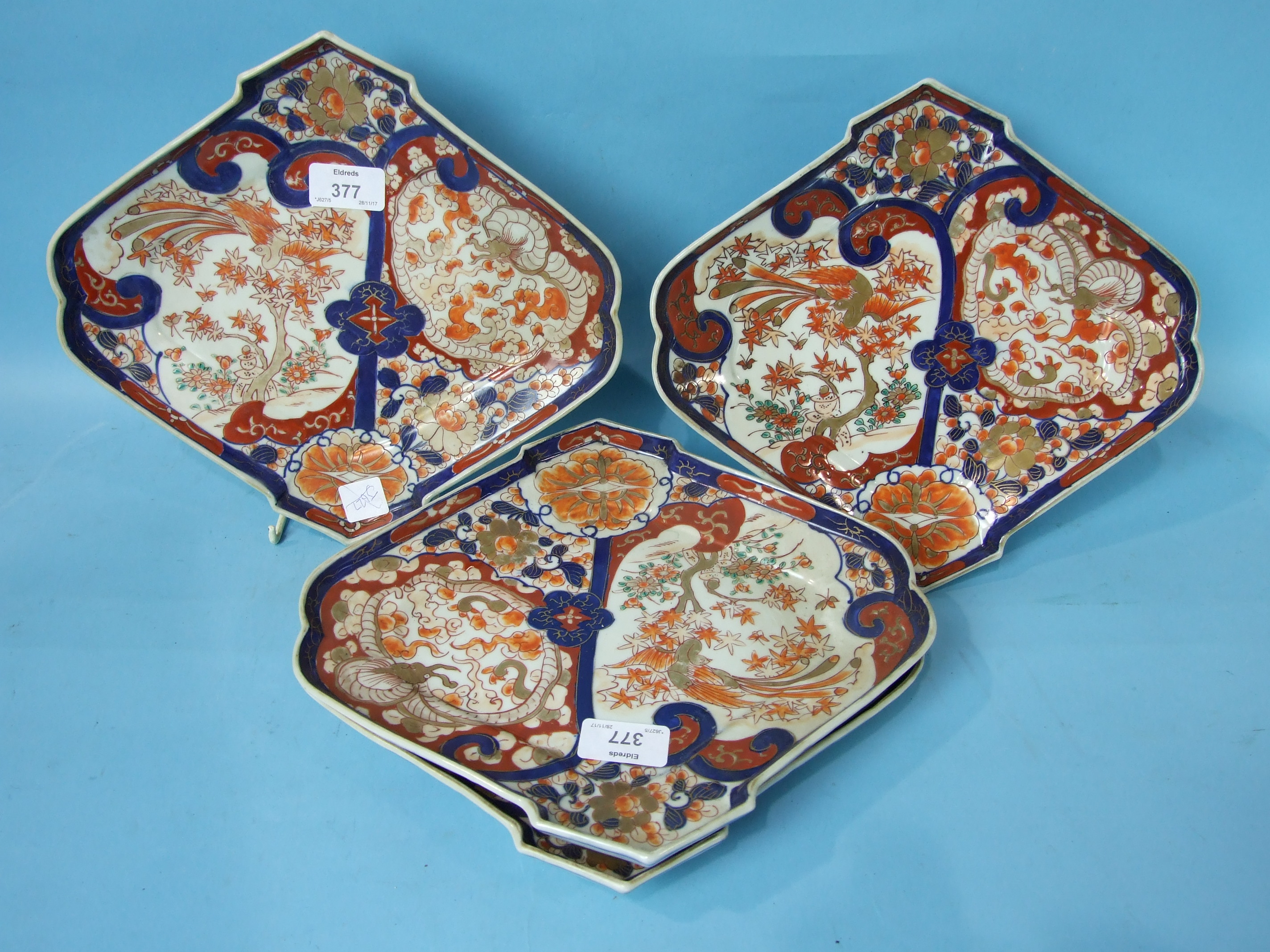 Lot 377 - A set of four Japanese Imari shaped fan dishes, 29cm.