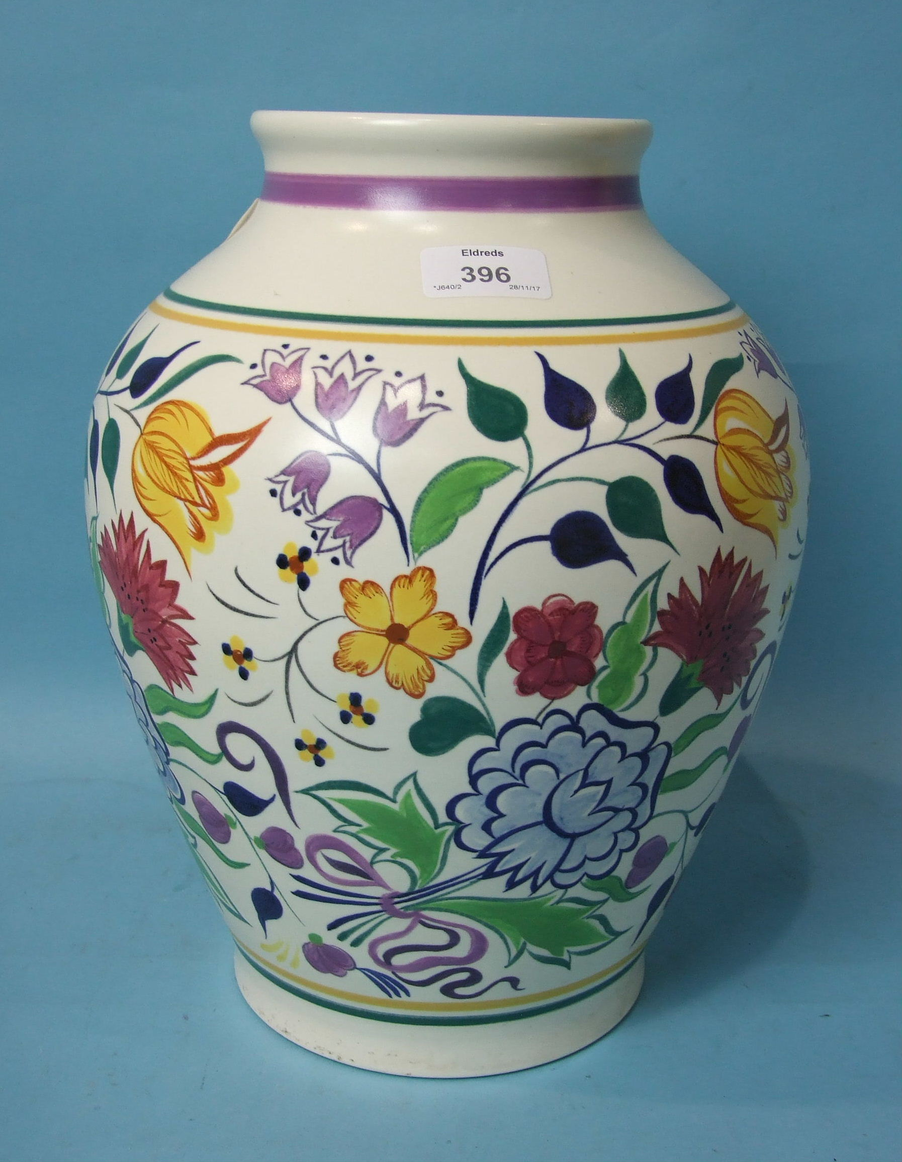 Lot 396 - A large Poole Pottery vase of ovoid form with polychrome painted decoration of stylised flowers