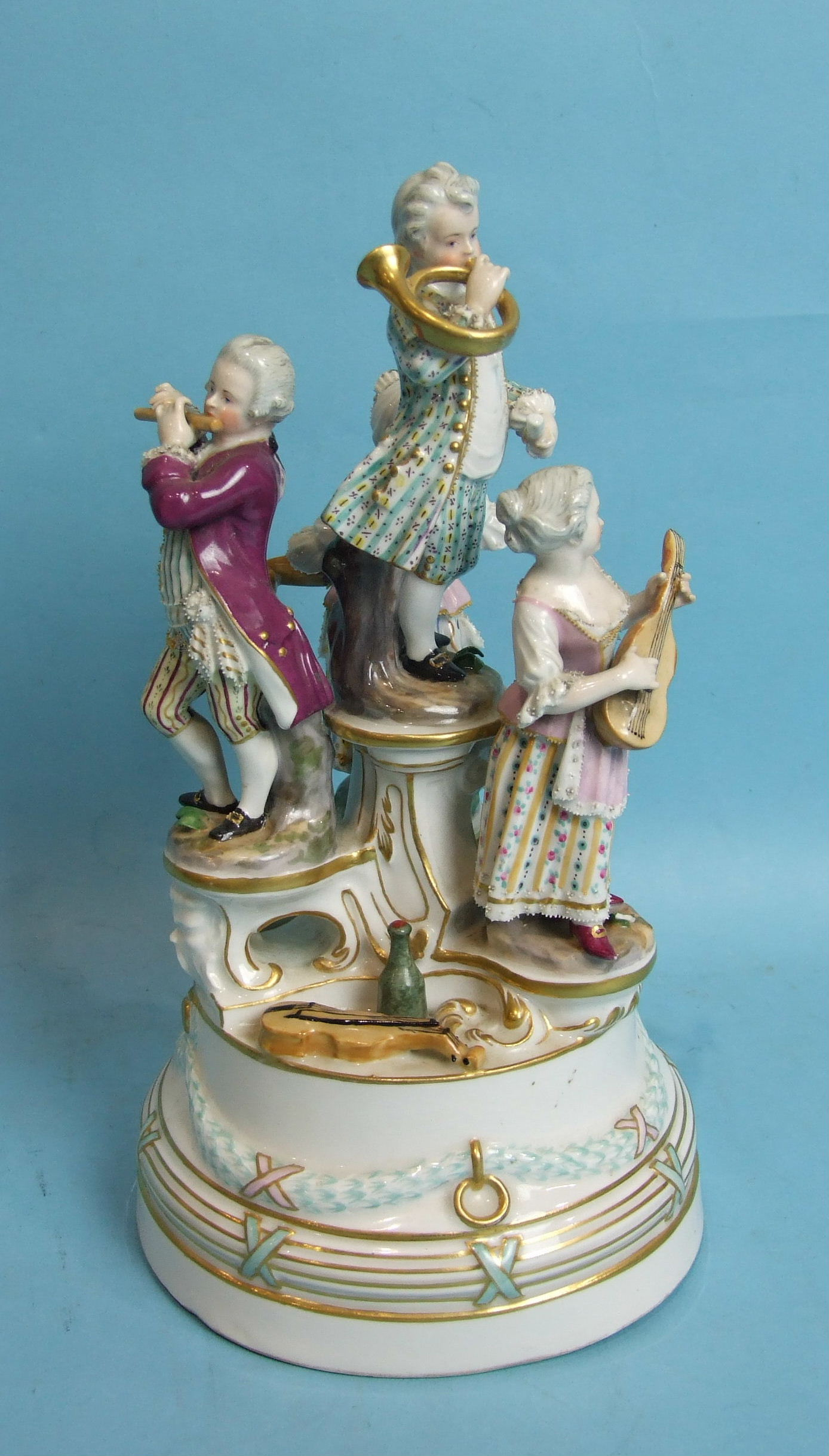 Lot 389 - A 19th century Vienna porcelain group of four child musicians, on a circular plinth base, beehive