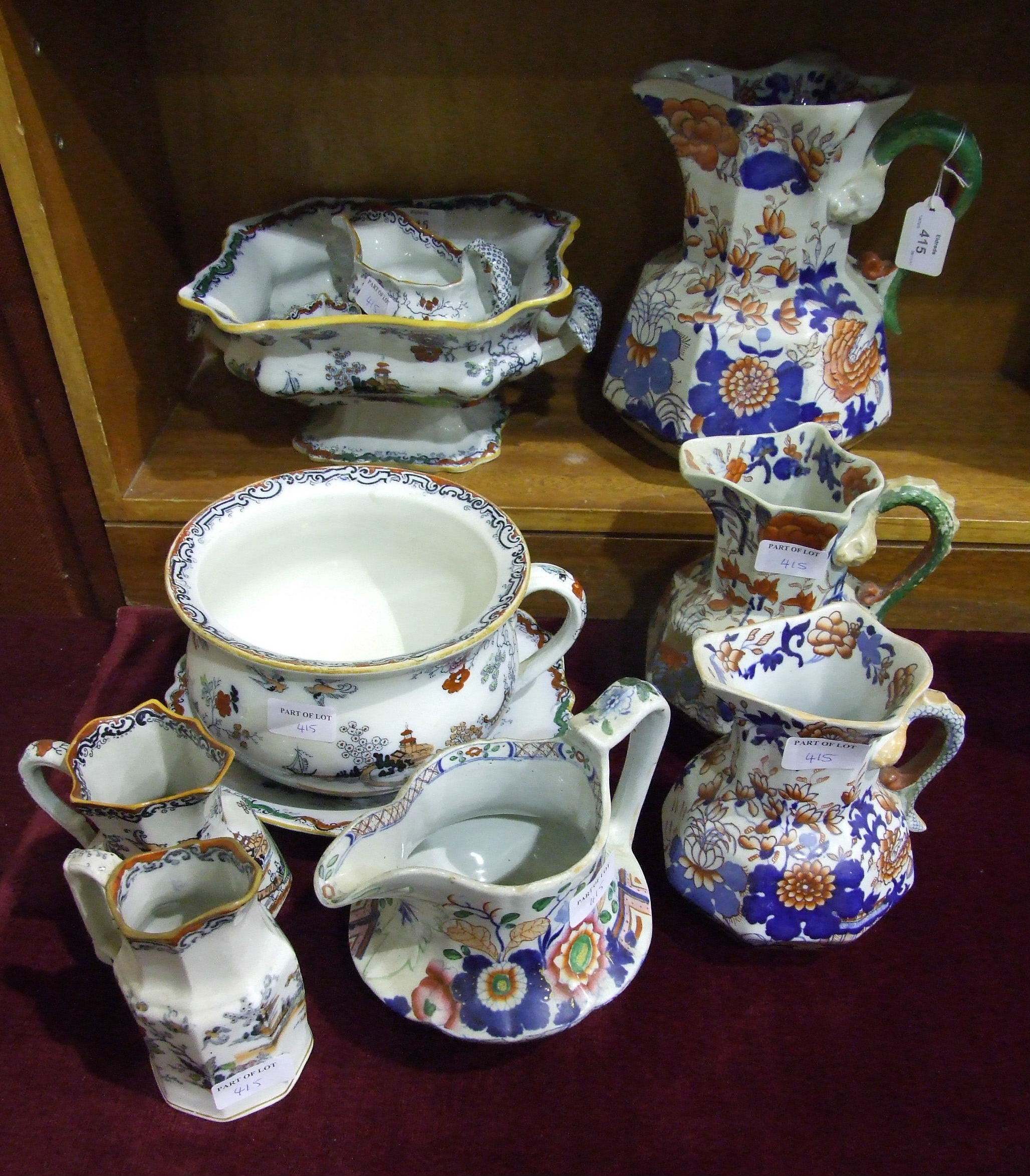 Lot 415 - Three Masons Ironstone octagonal jugs decorated in Imari colours, 24cm to 17cm, one with old