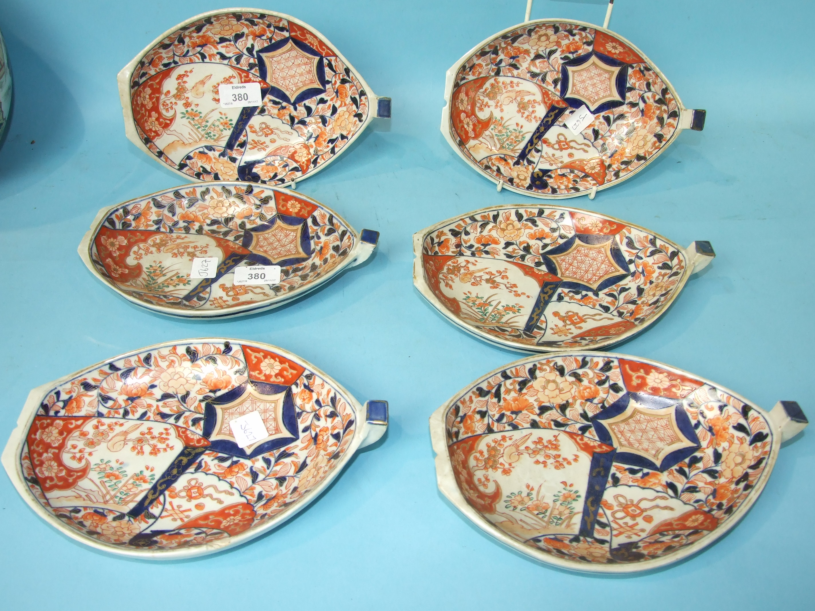 Lot 380 - A set of six Japanese Imari boat-shaped dishes, 24cm long.