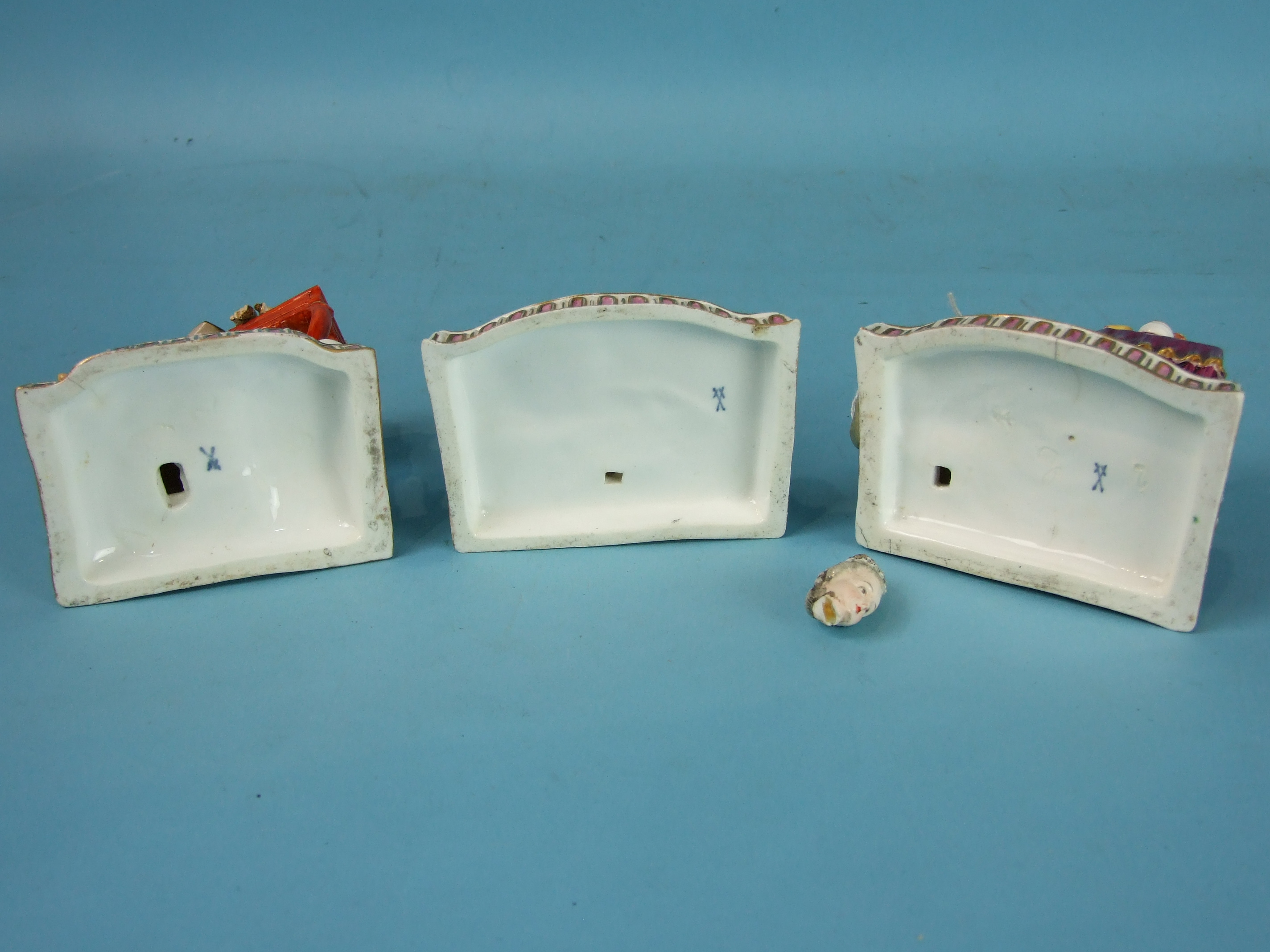 Lot 409 - A set of three English porcelain models of the senses after the Meissen originals by Acier, probably