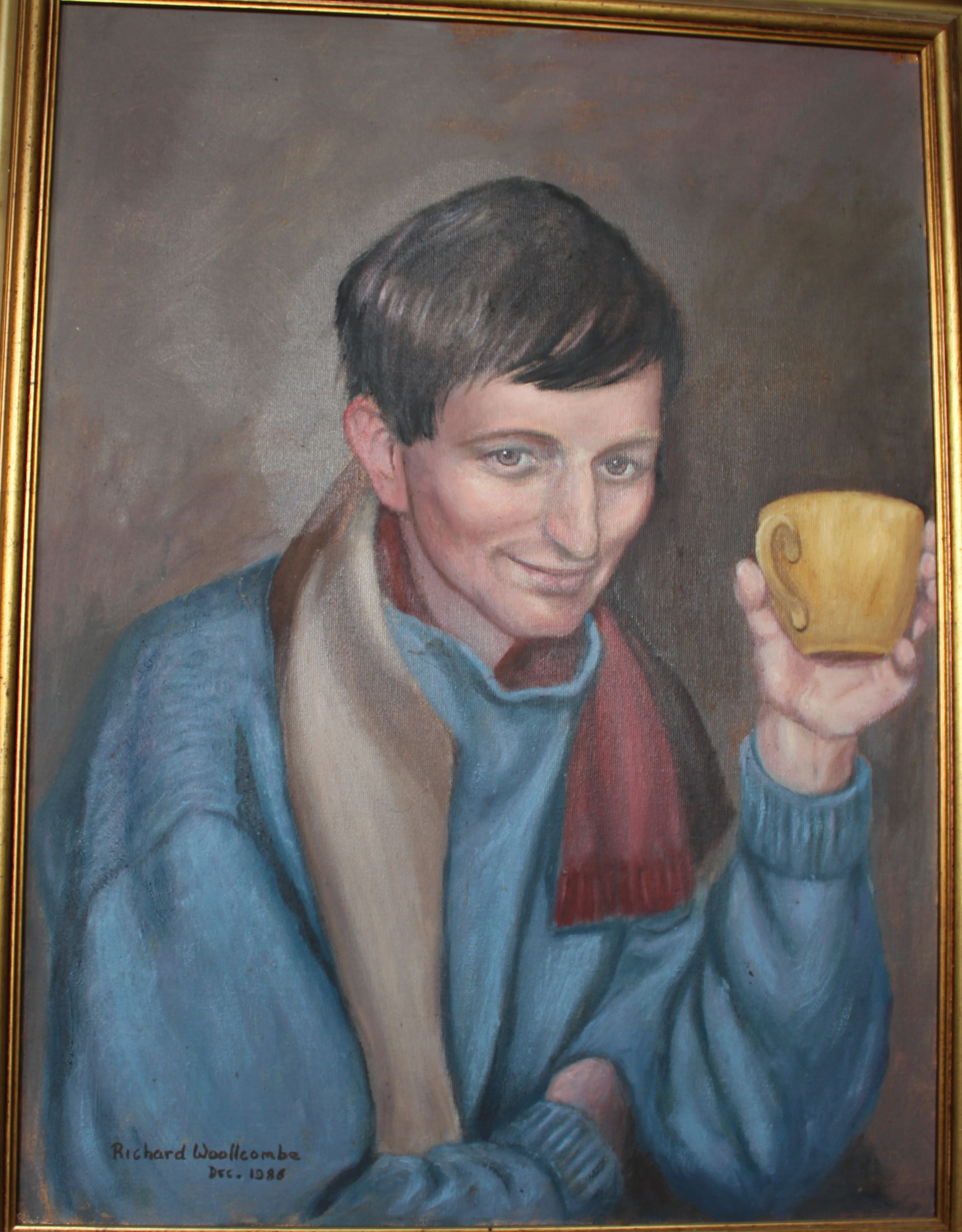 •PORTRAIT OF GRAHAM WOOLLCOMBE WEARING A RED SCARF AND HOLDING A YELLOW TEA CUP Signed framed oil on