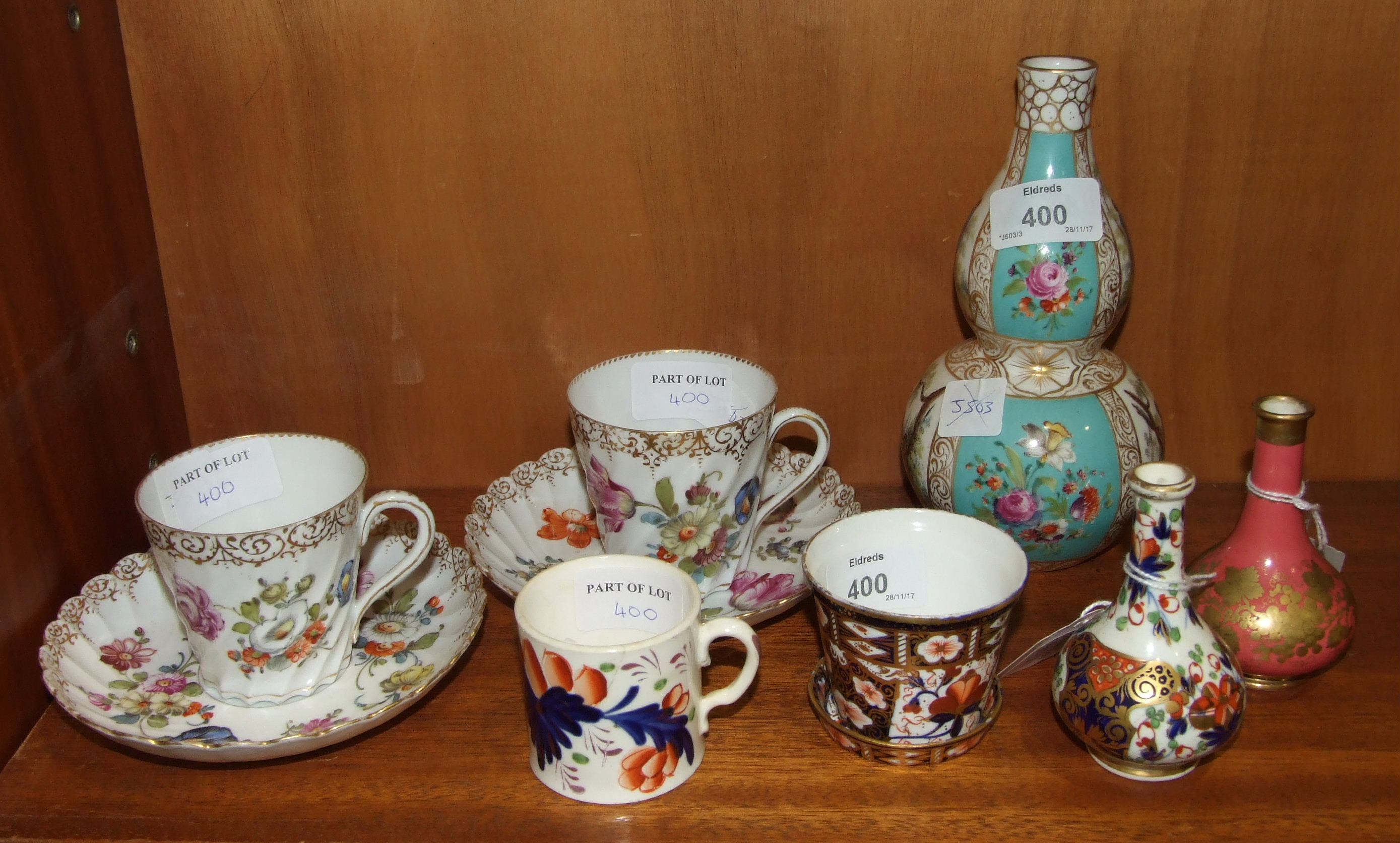 Lot 400 - A Dresden porcelain double-gourd-shaped vase, 18cm high, a pair of similar cups and saucers and four