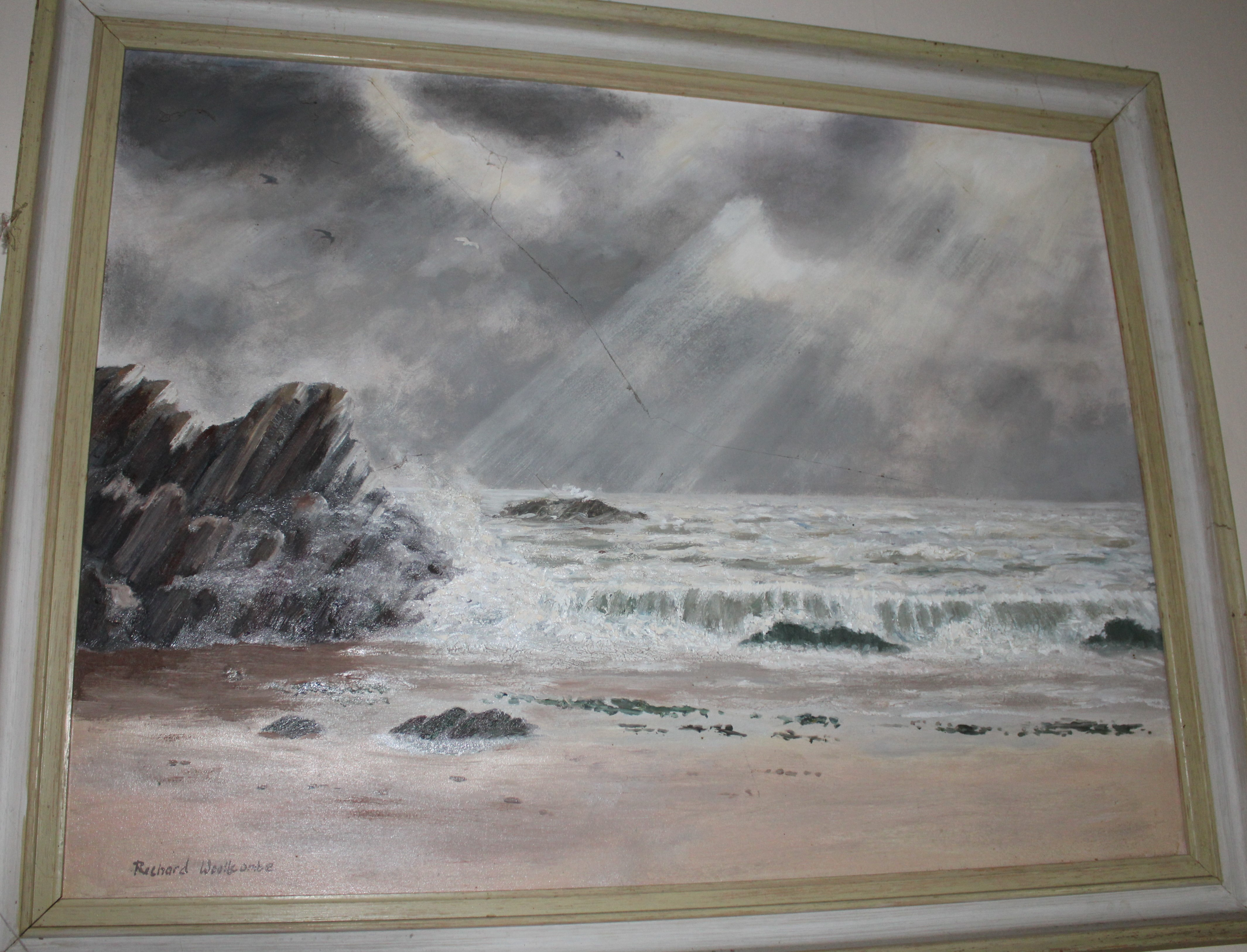 •WAVES BREAKING ON A ROCKY BEACH Signed framed oil on board, 45 x 59cm.