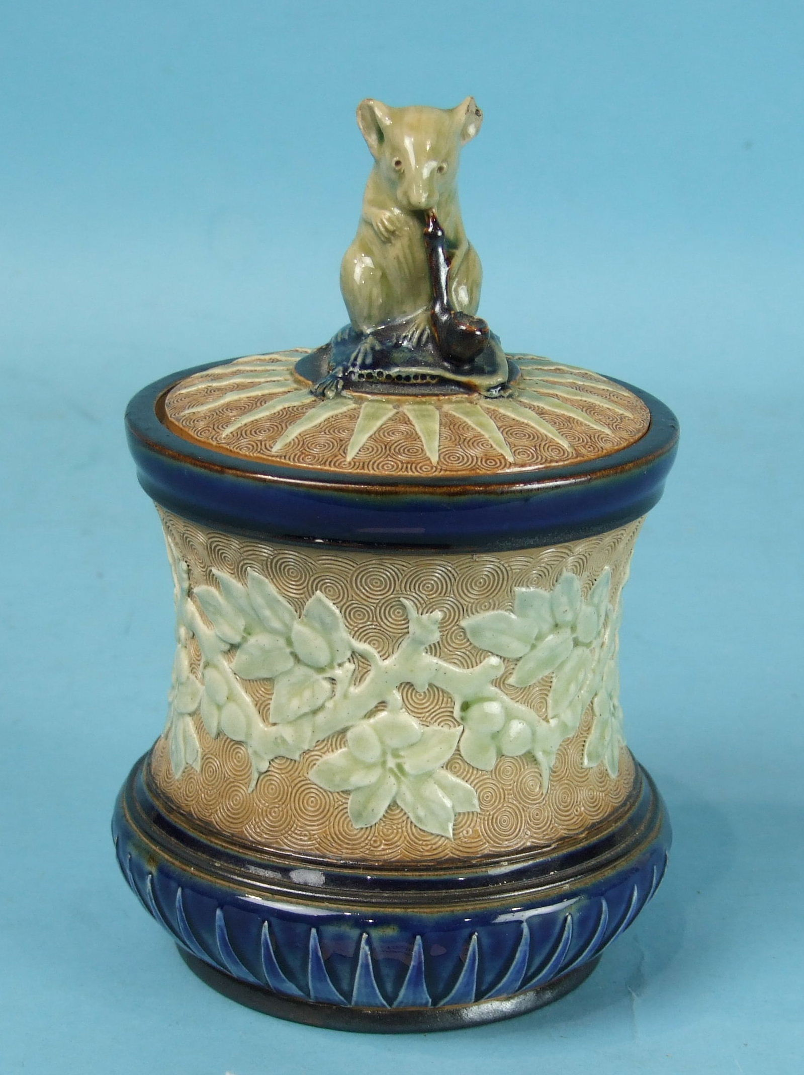 Lot 413 - A Doulton Burslem stoneware tobacco jar and cover of waisted form, decorated overall in blue and