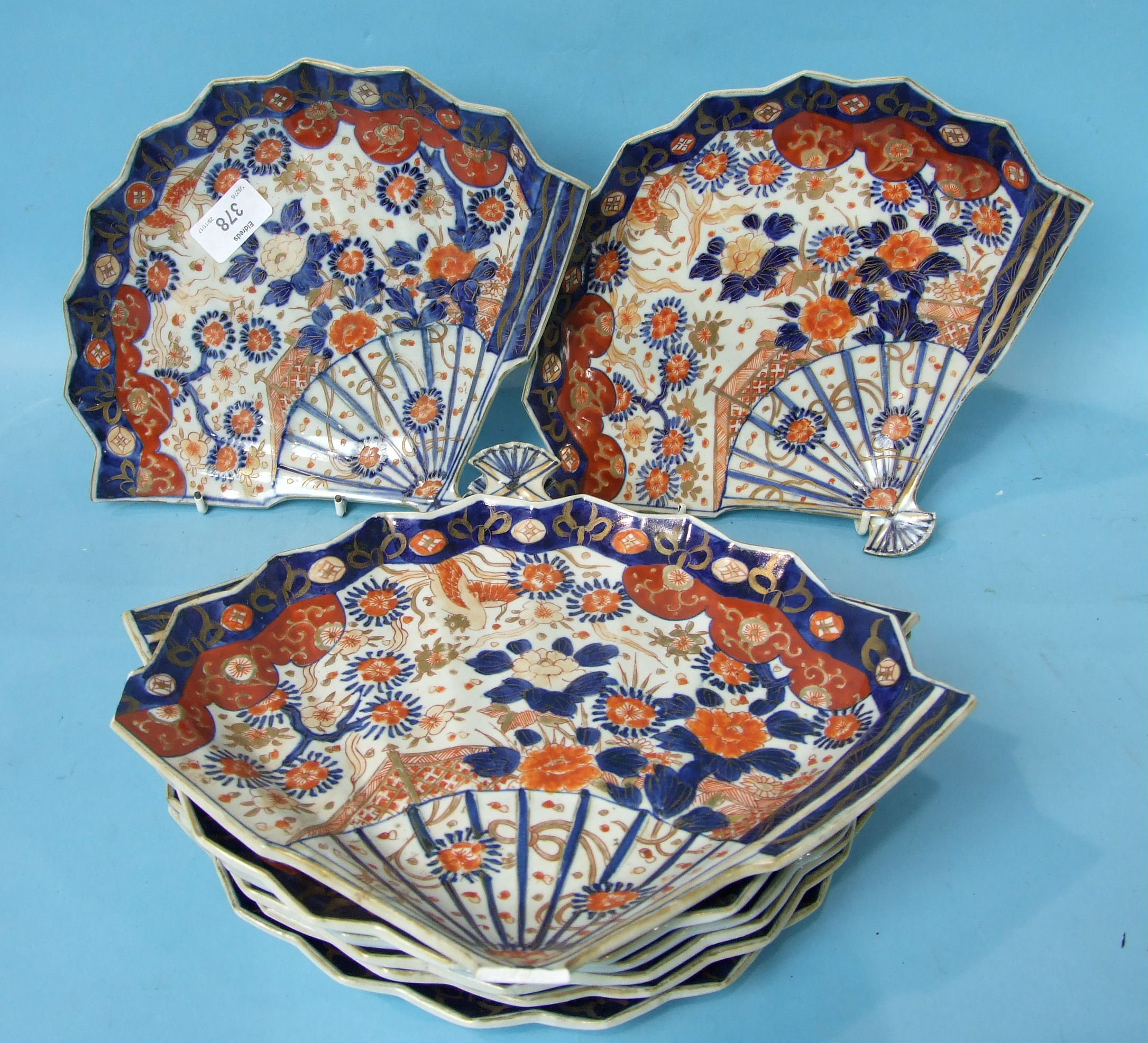 Lot 378 - A set of eight Japanese Imari shaped fan dishes, 28cm, (1 a/f).