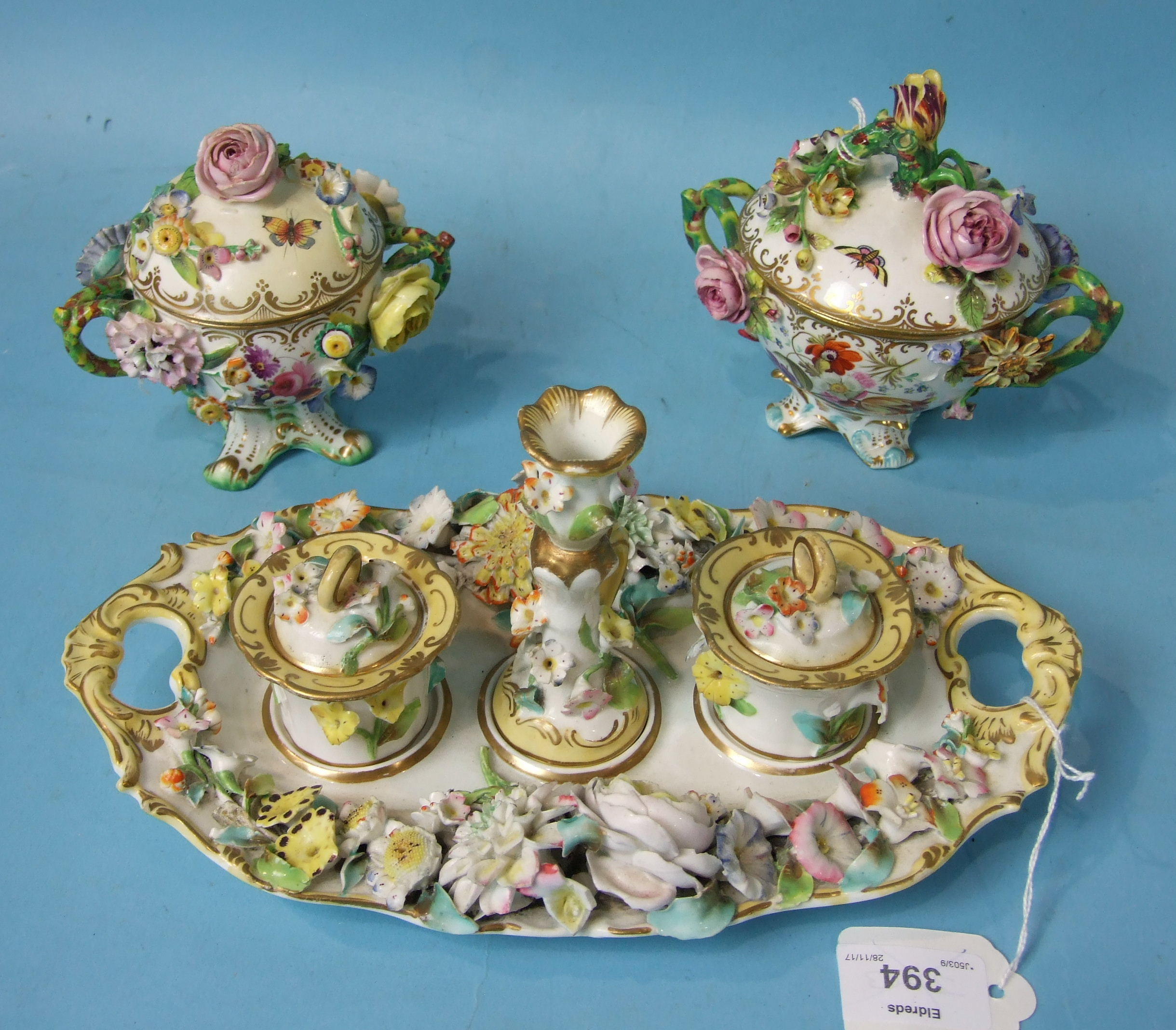 Lot 394 - Two mid-19th century Coalport pot pourri vases and covers painted and encrusted with flowers, on