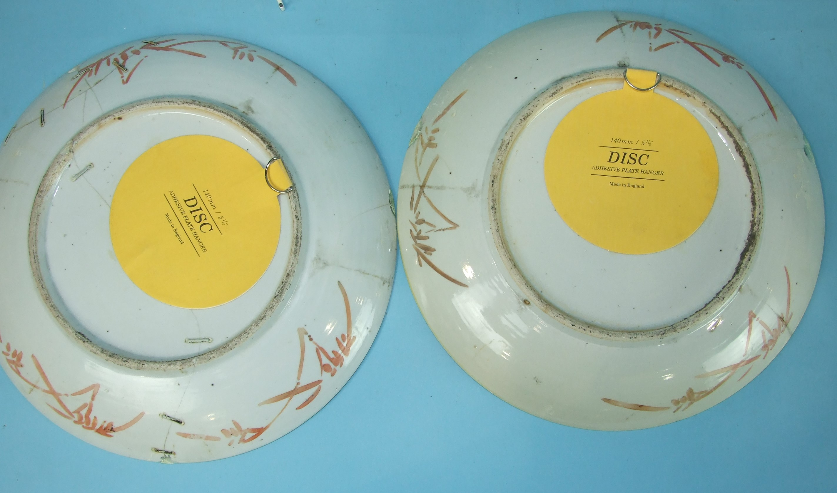 Lot 365 - A pair of large 19th century famille rose dishes decorated with musicians, 36.5cm diameter, (a/f).