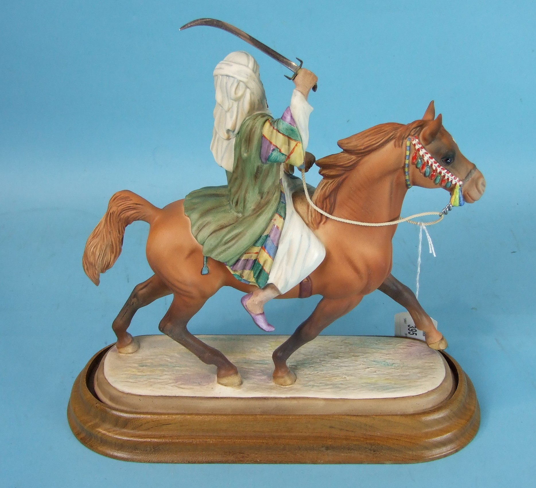 Lot 395 - A Beswick figure of a Bedouin Arab Warrior on horseback, impressed 2275 to base, 27cm high, raised