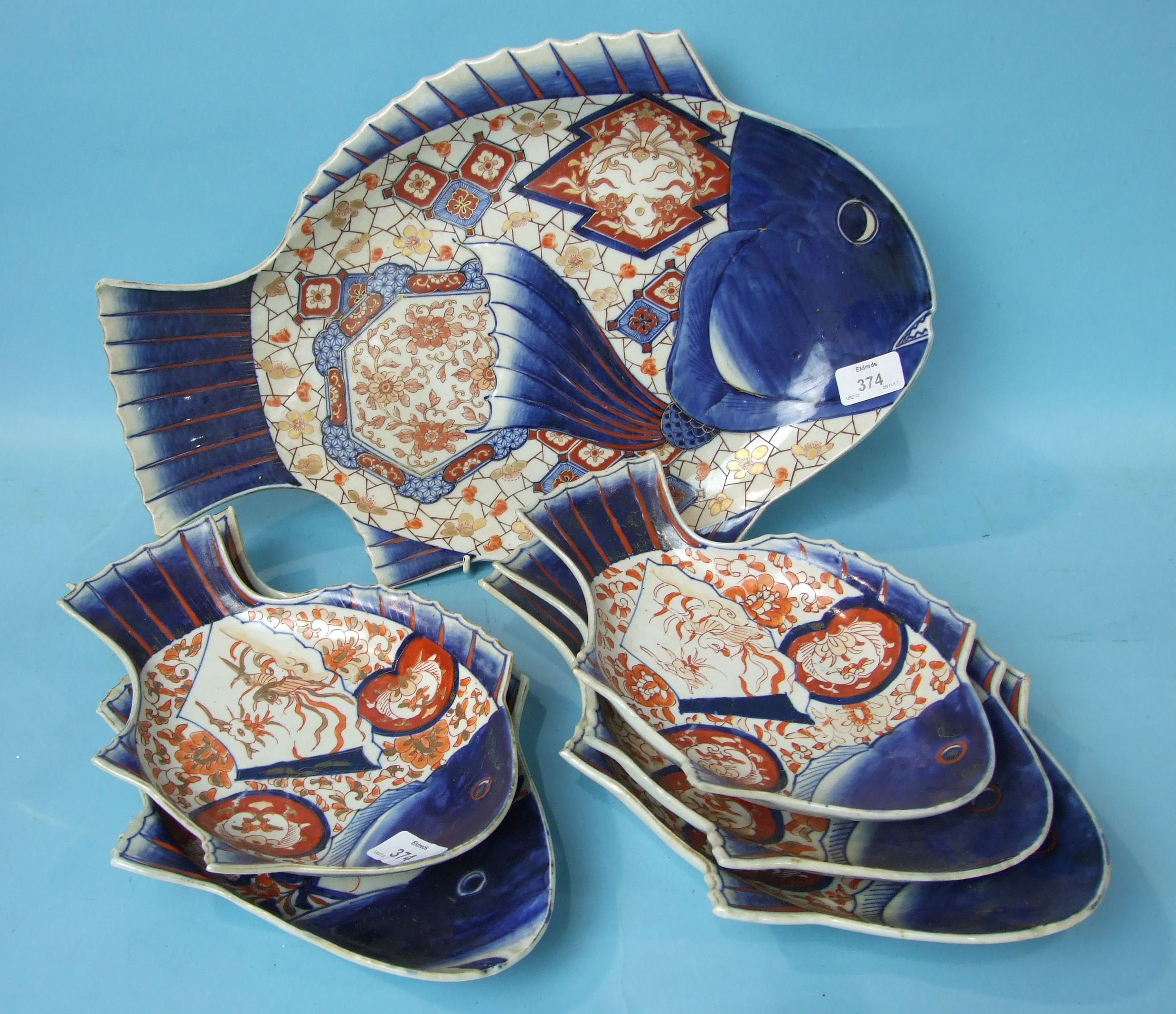 Lot 374 - A large 19th century Japanese Imari porcelain fish-shaped dish and five similar smaller dishes,