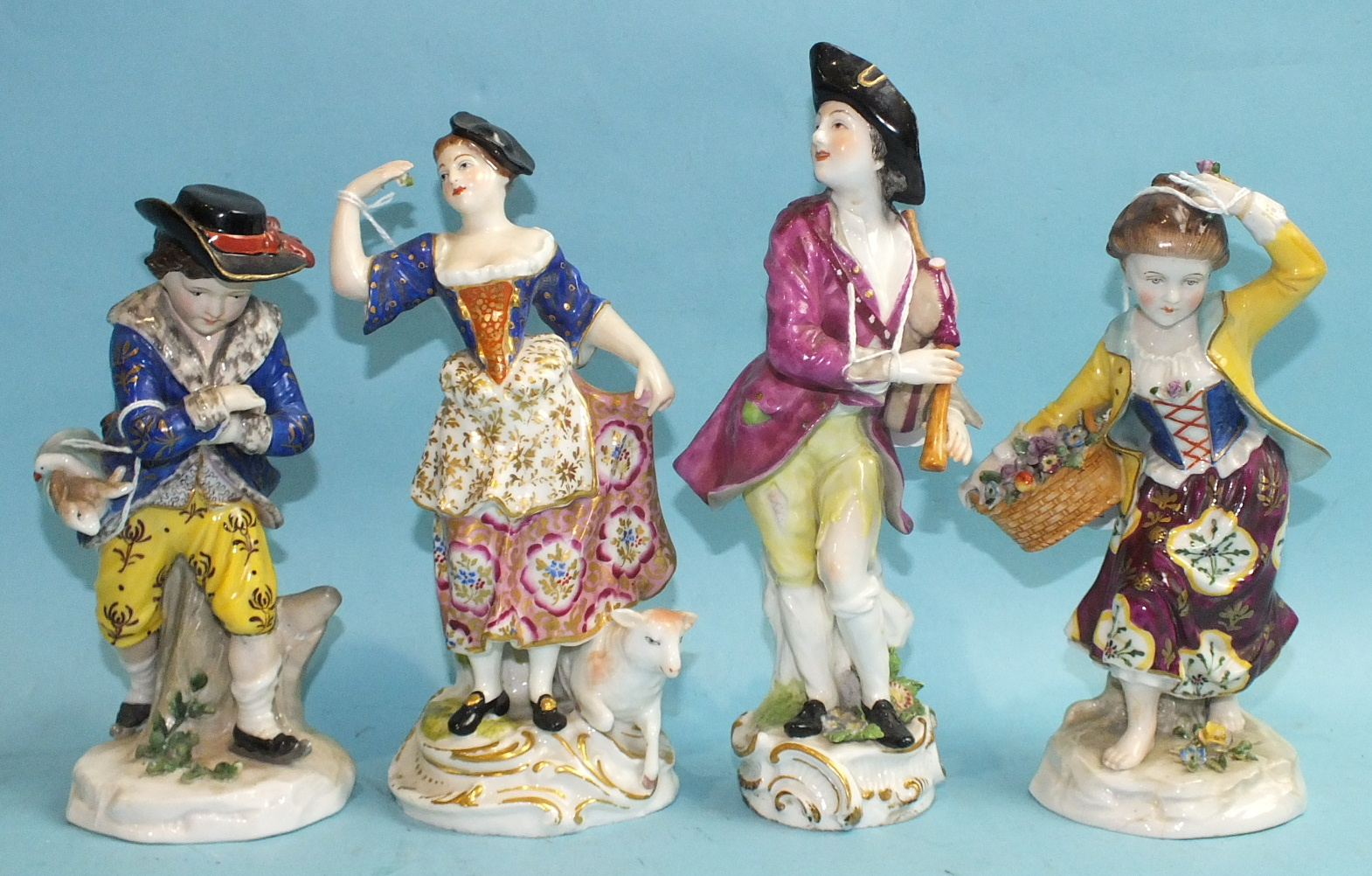 Lot 390 - Four Continental porcelain figures engaged in rural pursuits.