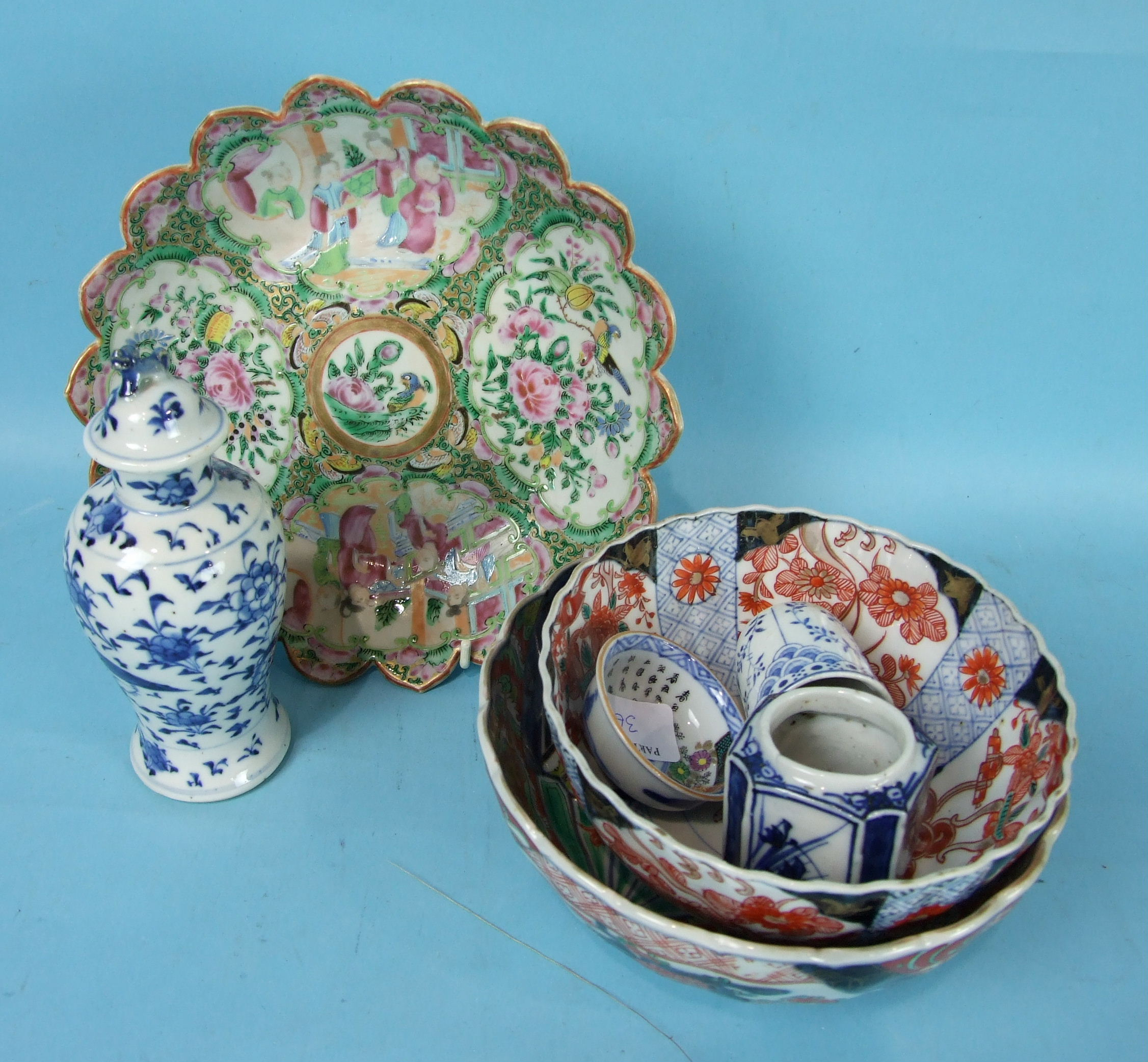 Lot 363 - A 19th century Chinese Canton shaped circular dish, a small blue and white vase and cover, two