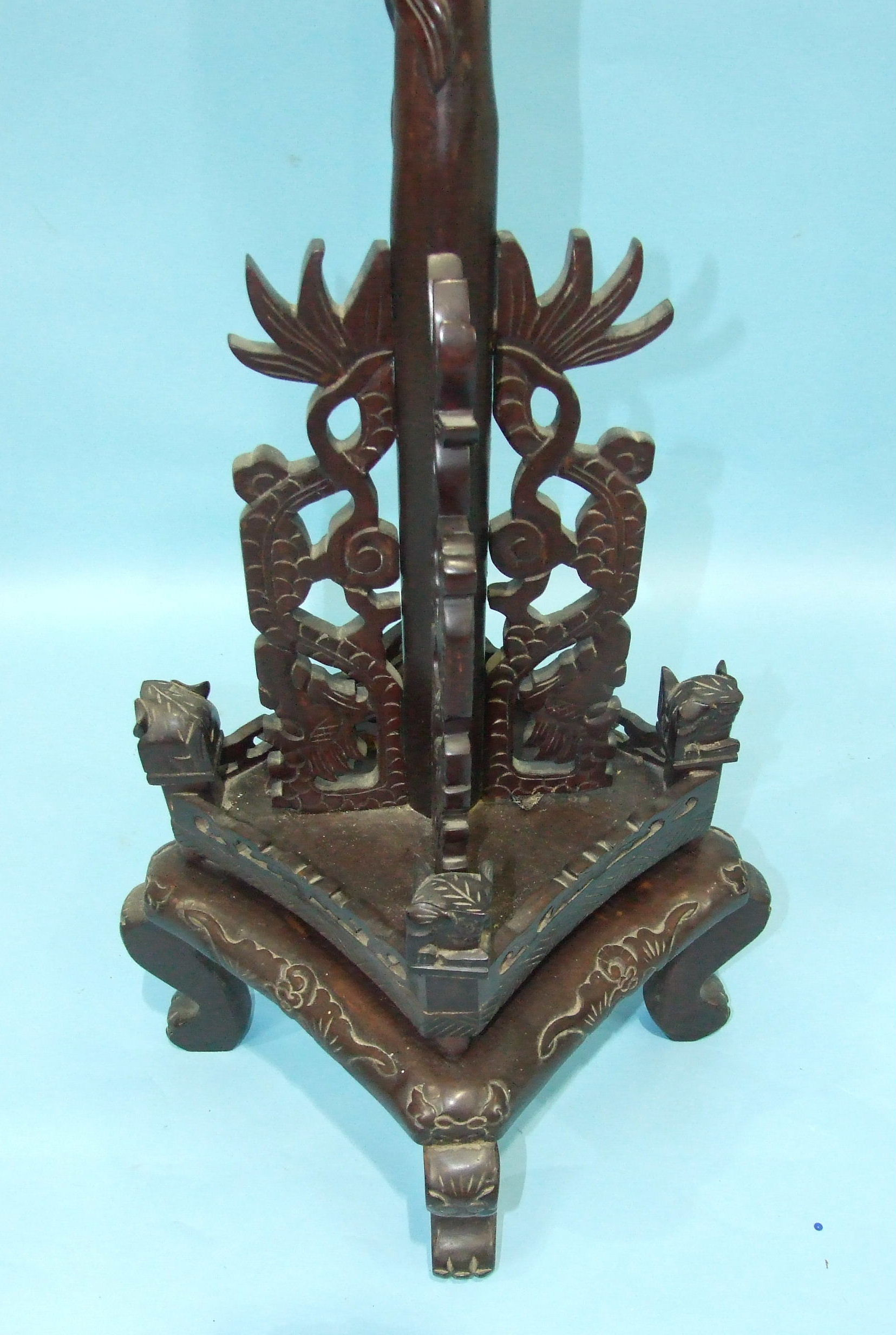 Lot 247 - A 20th century Chinese carved hardwood lamp standard, the column carved with dragons to a square