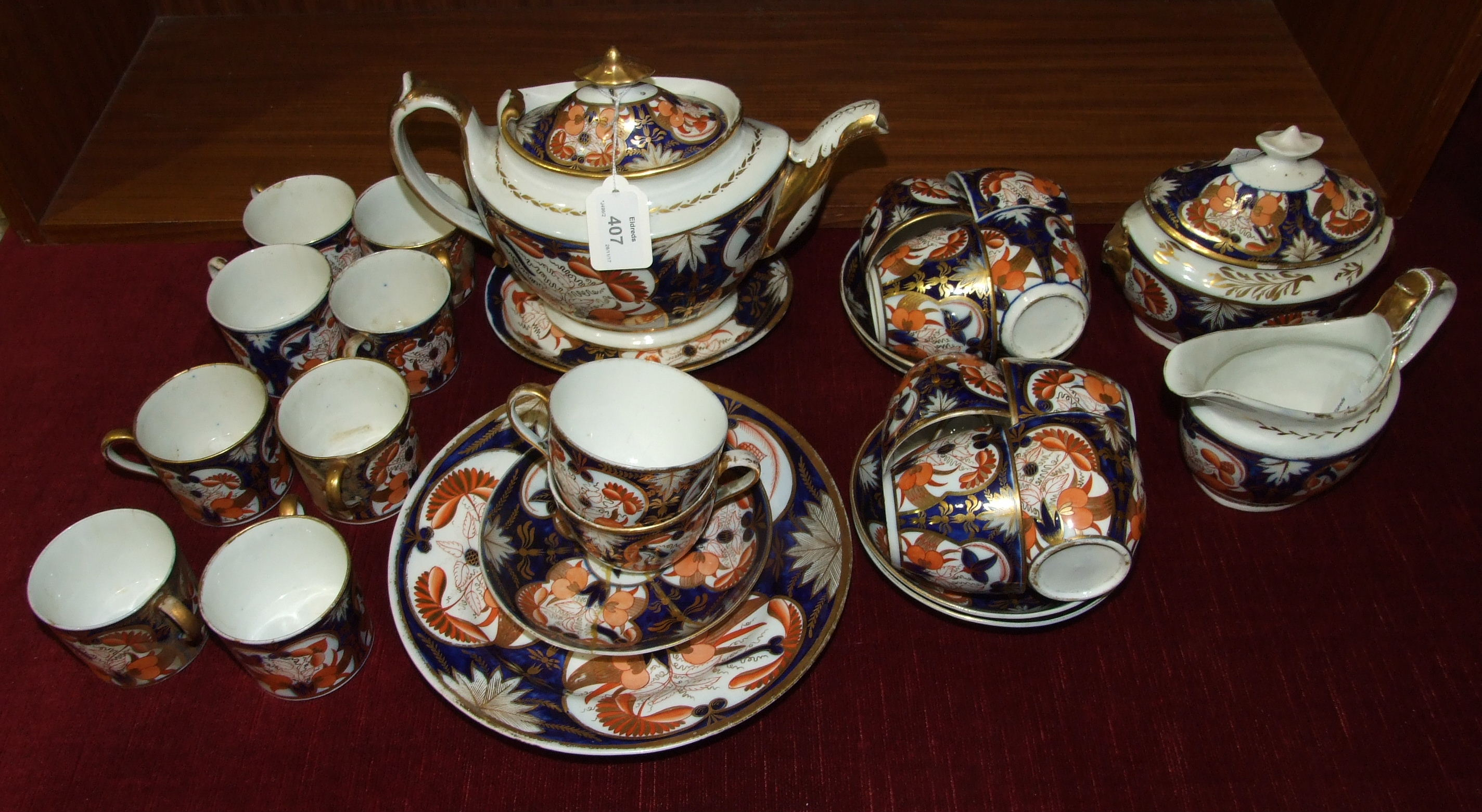 Lot 407 - An early-19th century English porcelain Imari pattern part tea service, thirty pieces.