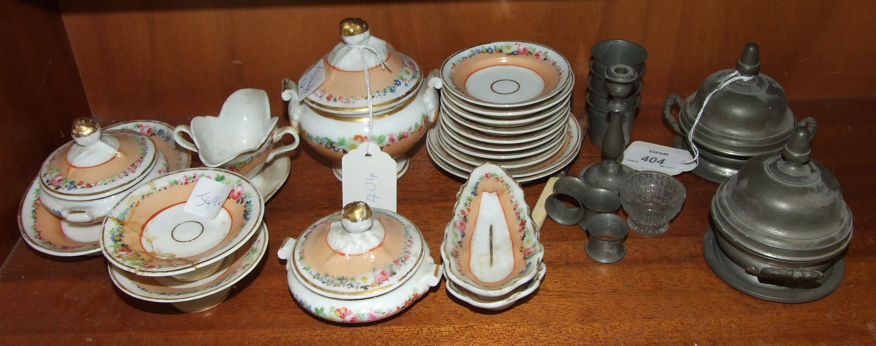 Lot 404 - A 19th century porcelain part tea service for a doll together with a pair of pewter tureens and