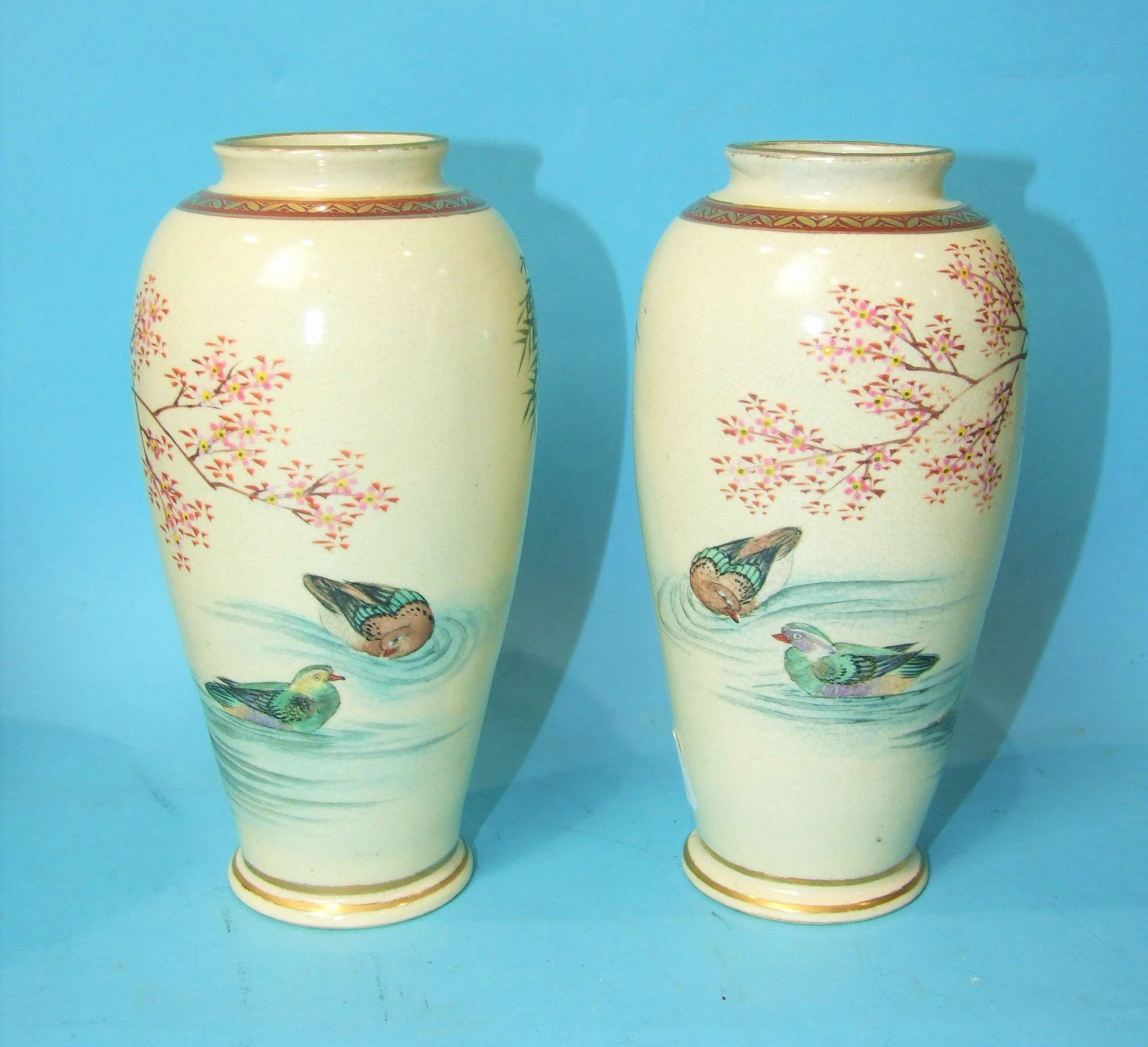Lot 372 - A pair of Japanese Satsuma vases decorated with ducks, 18cm high, a similar box and cover, (a/f),