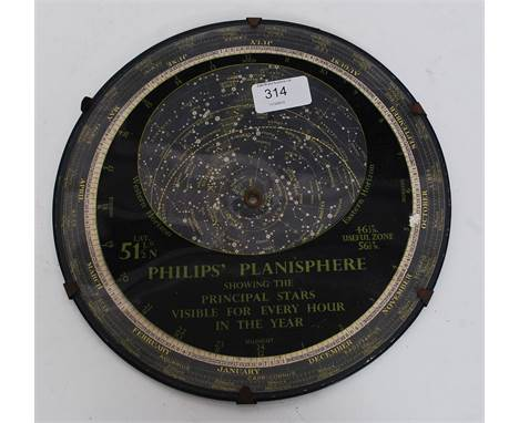 PHILIPS PLANISPHERE. A vintage 20th century  large Philips Planisphere, the reverse with printed explanation. Measures 25.5cm