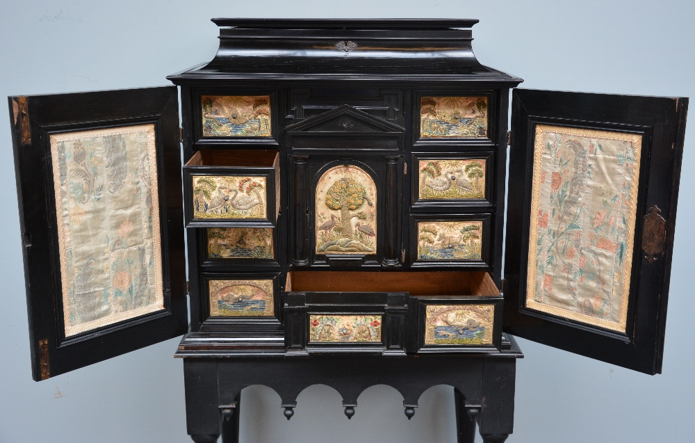 Lot 407 - An exceptional 17thC Flemish ebony and rosewood cabinet-on-stand, silk embroidered inside, the