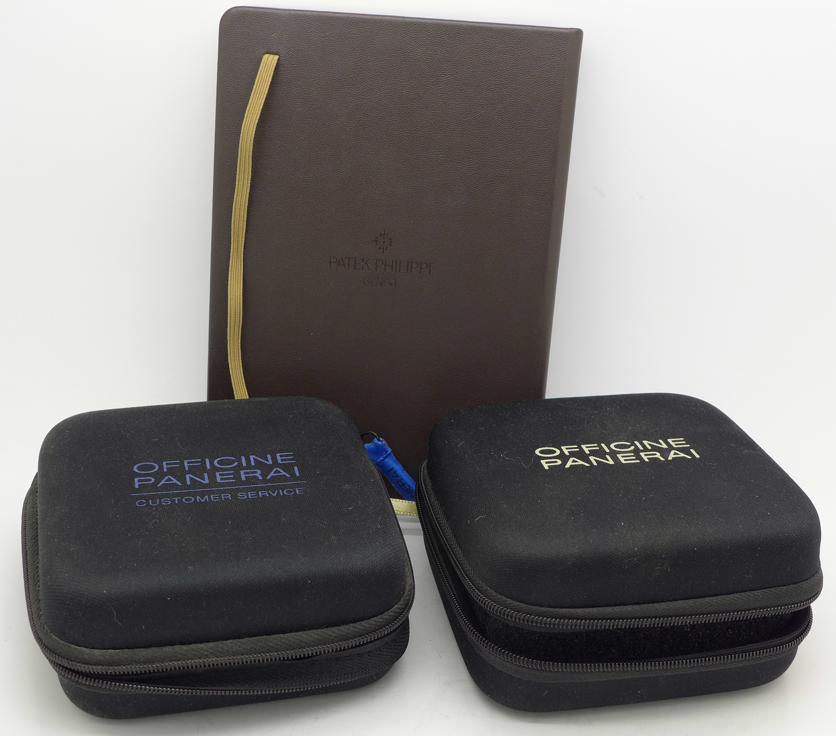 Lot 632 - A Patek Philippe notebook and two cases marked Officine Panerai