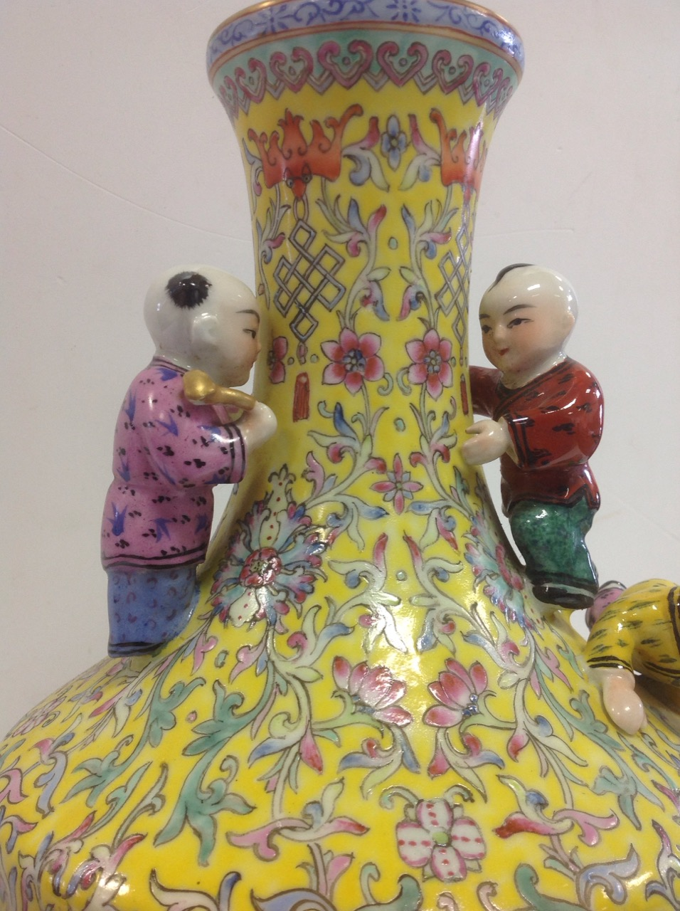 Lot 1 - A Chinese republican style vase of baluster shape, mounted with four children, the yellow ground