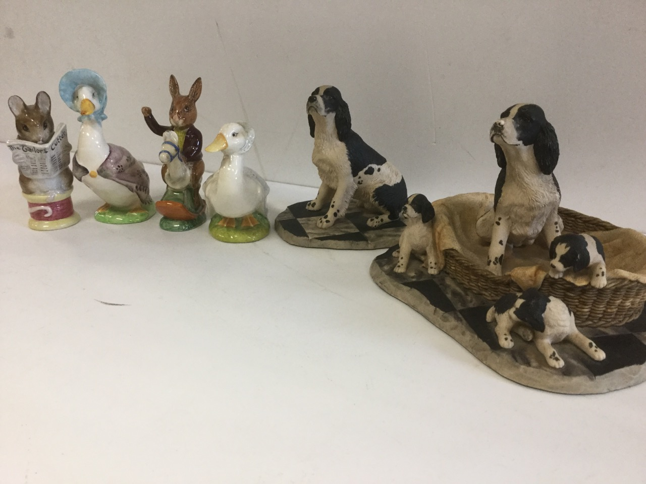 Lot 10 - Three Beswick Beatrix Potter figurines - Jemima Puddleduck, Tailor of Gloucester, and Rebeccah