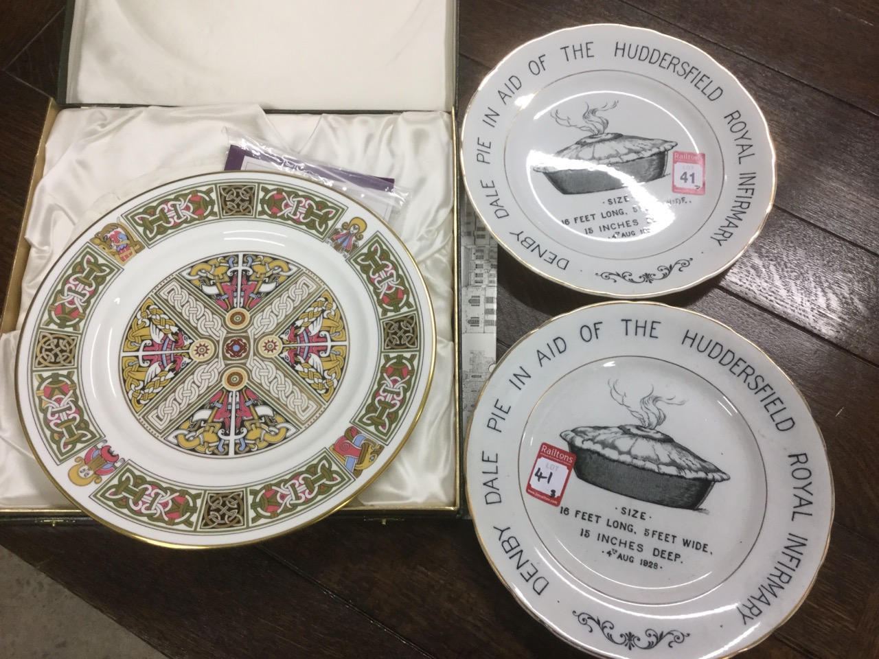 Lot 41 - A pair of 1928 commemorative Denby Dale pie plates in aid of Huddersfield Royal Infirmary, with gilt