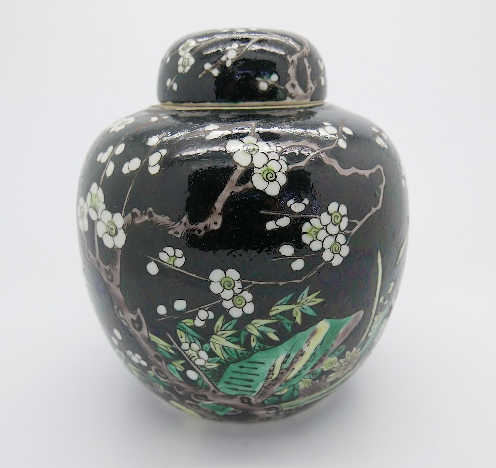 Lot 66 - A Chinese famille verte ginger jar & cover decorated with blossom foilage, on black ground, - six